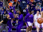 The University of Evansville Purple Aces bench reacts to their team netting another three-pointer against the Loyola Ramblers in the second half at Ford Center in Evansville, Ind., Tuesday, Jan. 8, 2019. The Purple Aces rolled over the Ramblers, 67-48.