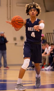 Khristian Lander, passing to a teammate against Memorial, scored Reitz's first 13 points in the Panthers' wild 72-70 win over Bosse.