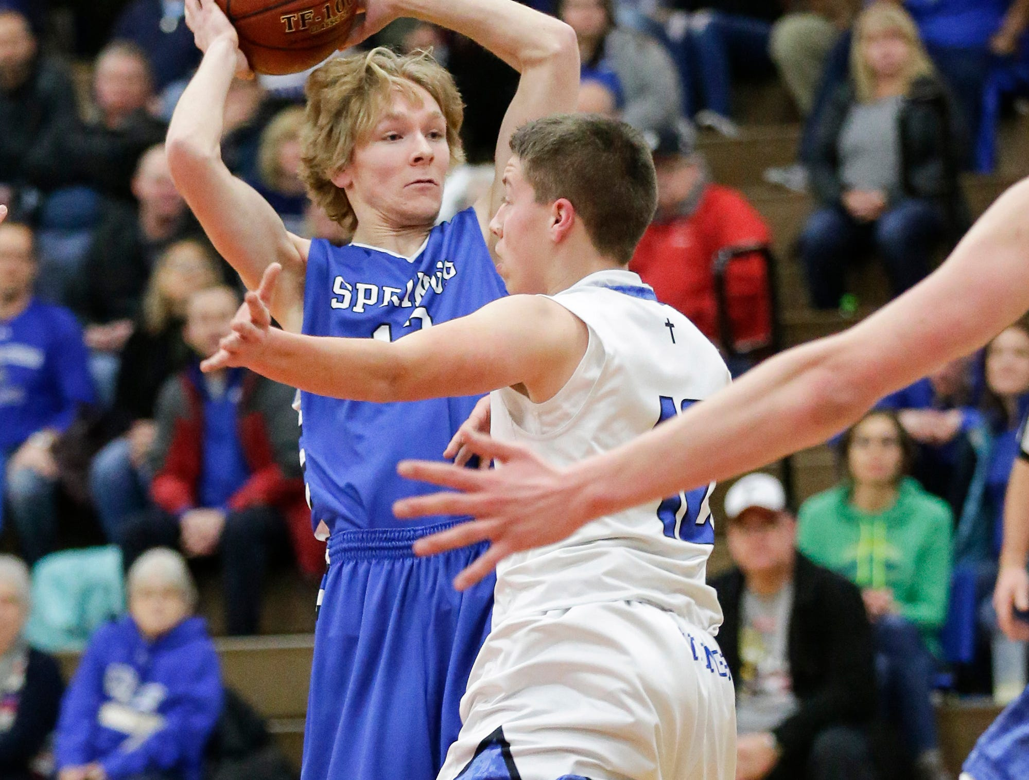 St. Mary's Spring Academy boys basketball's Myles Ottery tries to get a pass off past Winnebago Lutheran Academy' Bo Miller Tuesday, Jan. 8, 2019, during their game in Fond du Lac. Winnebago Lutheran Academy won the game 69-66.
