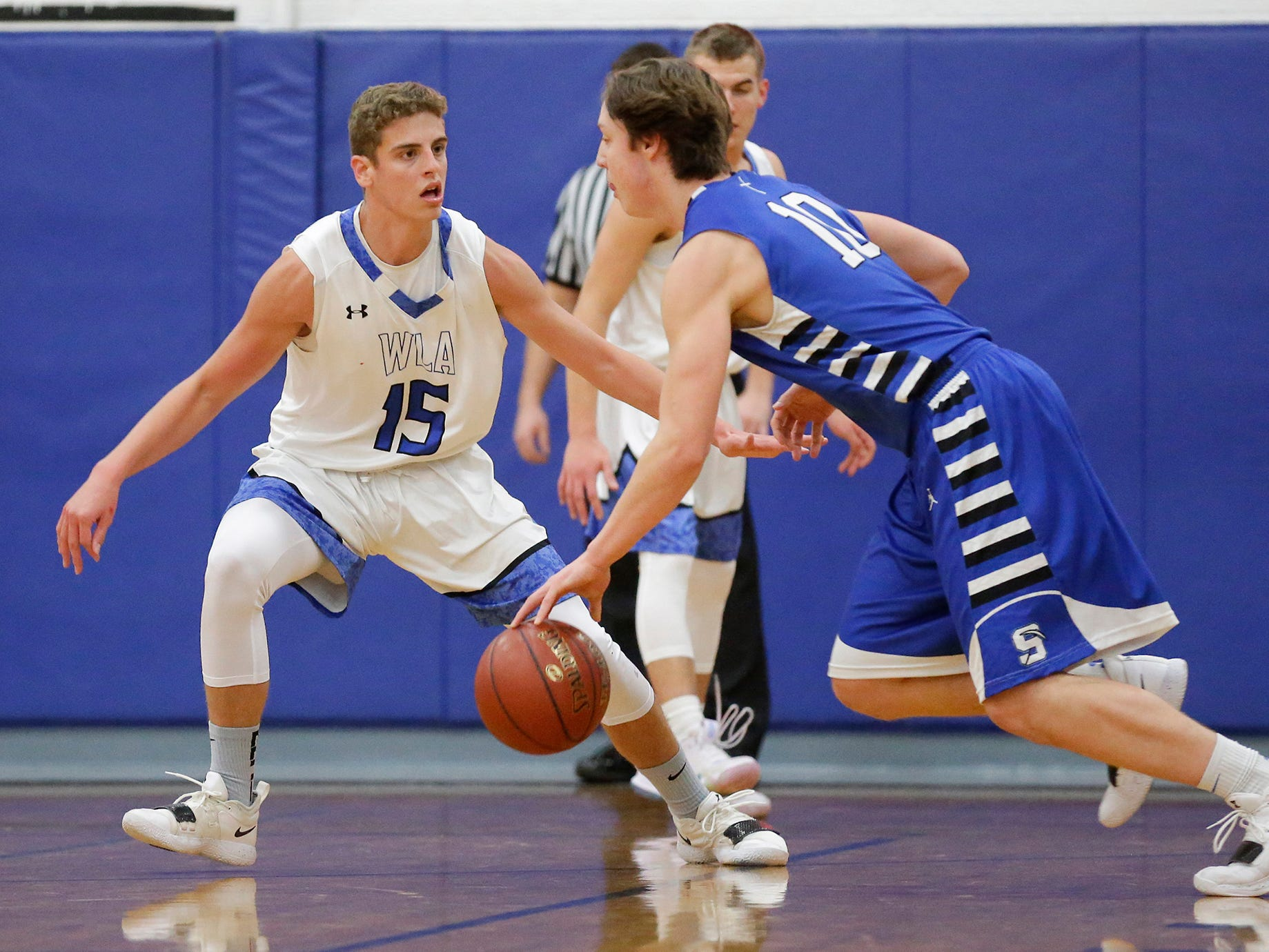 Winnebago Lutheran Academy boys basketball's Zach Loehr defends against St. Mary's Springs Academy's Cade Christensen Tuesday, January 8, 2019 during their game in Fond du Lac. Winnebago Lutheran Academy won the game 69-66. Doug Raflik/USA TODAY NETWORK-Wisconsin