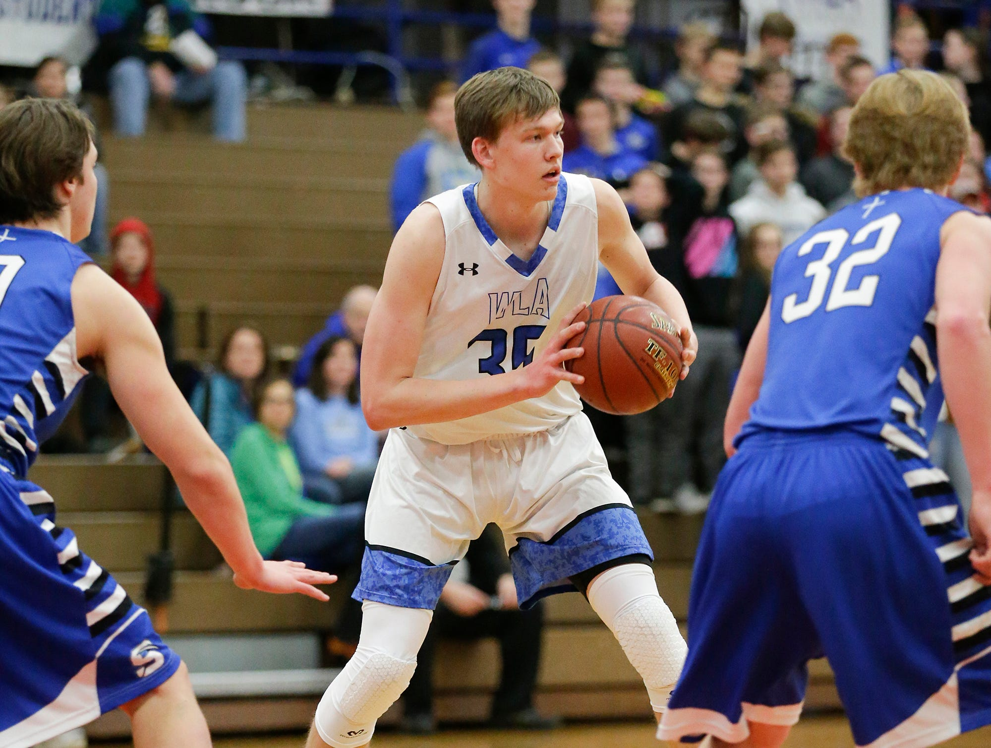 Winnebago Lutheran Academy boys basketball's Gabe Pruss looks to pass against St. Mary's Springs Academy Tuesday, January 8, 2019 during their game in Fond du Lac. Winnebago Lutheran Academy won the game 69-66. Doug Raflik/USA TODAY NETWORK-Wisconsin