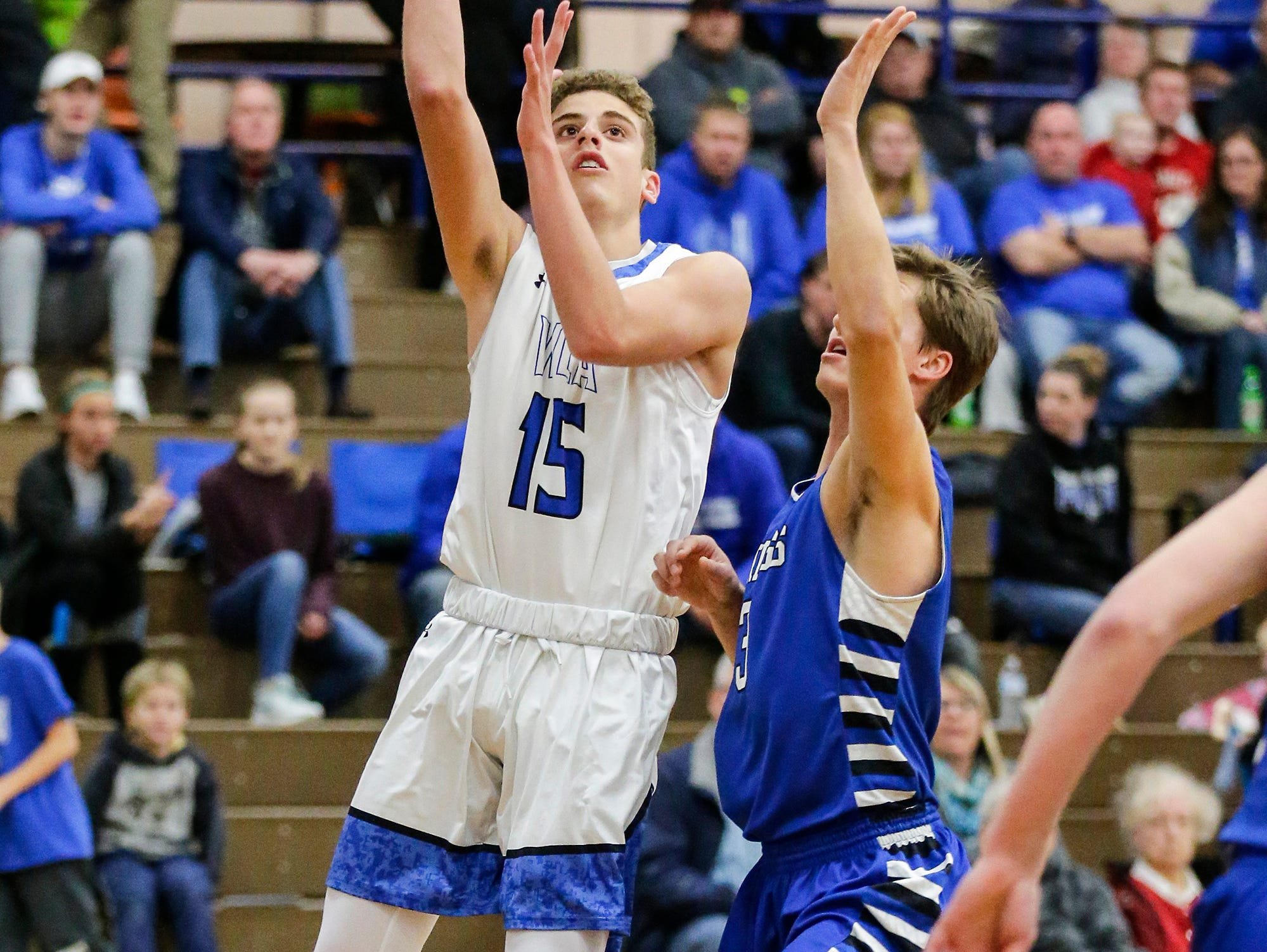 Winnebago Lutheran Academy boys basketball's Zach Loehr makes this shot against St. Mary's Springs Academy's Mitch Waechter Tuesday, January 8, 2019 during their game in Fond du Lac. Winnebago Lutheran Academy won the game 69-66. Doug Raflik/USA TODAY NETWORK-Wisconsin