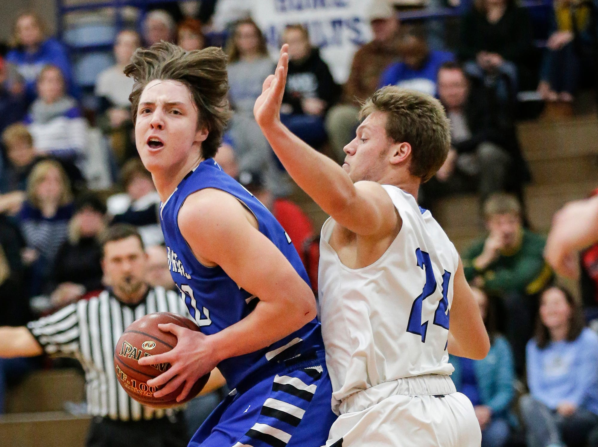 St. Mary's Spring Academy boys basketball's Cade Christensen tries to get around  Winnebago Lutheran Academy's Gideon Wenig Tuesday, January 8, 2019 during their game in Fond du Lac. Winnebago Lutheran Academy won the game 69-66. Doug Raflik/USA TODAY NETWORK-Wisconsin