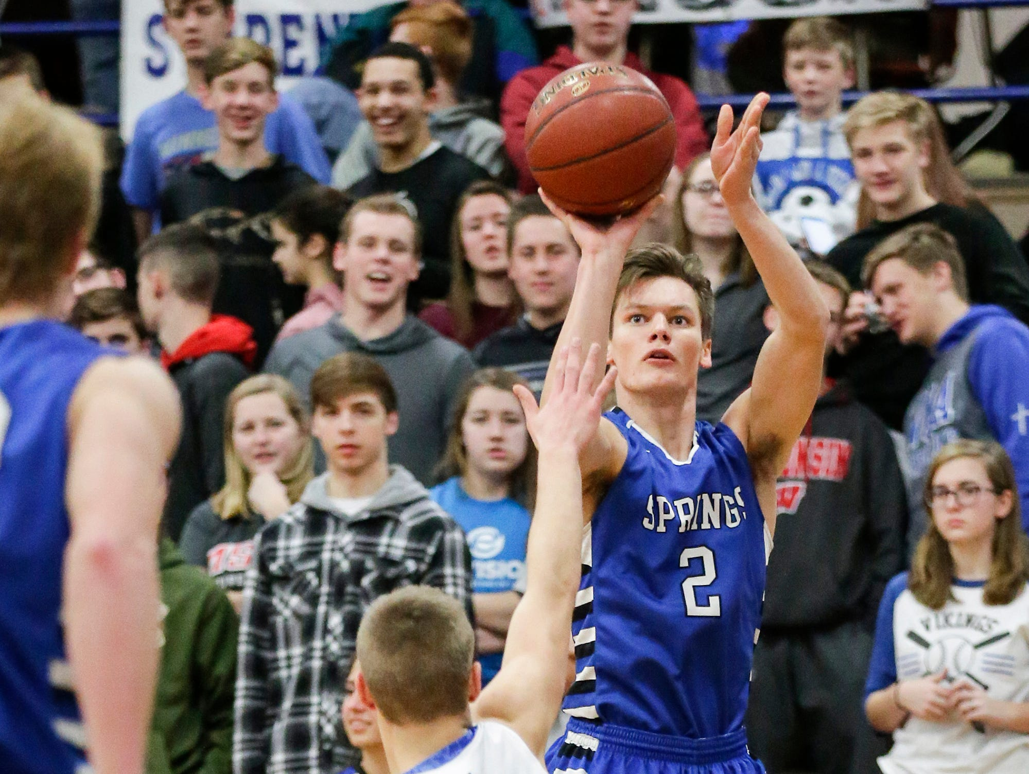 St. Mary's Spring Academy boys basketball's Matthew Moul attempts a shot over Winnebago Lutheran Academy's Donovan Schwartz Tuesday, Jan. 8, 2019 during their game in Fond du Lac. Winnebago Lutheran Academy won the game 69-66.