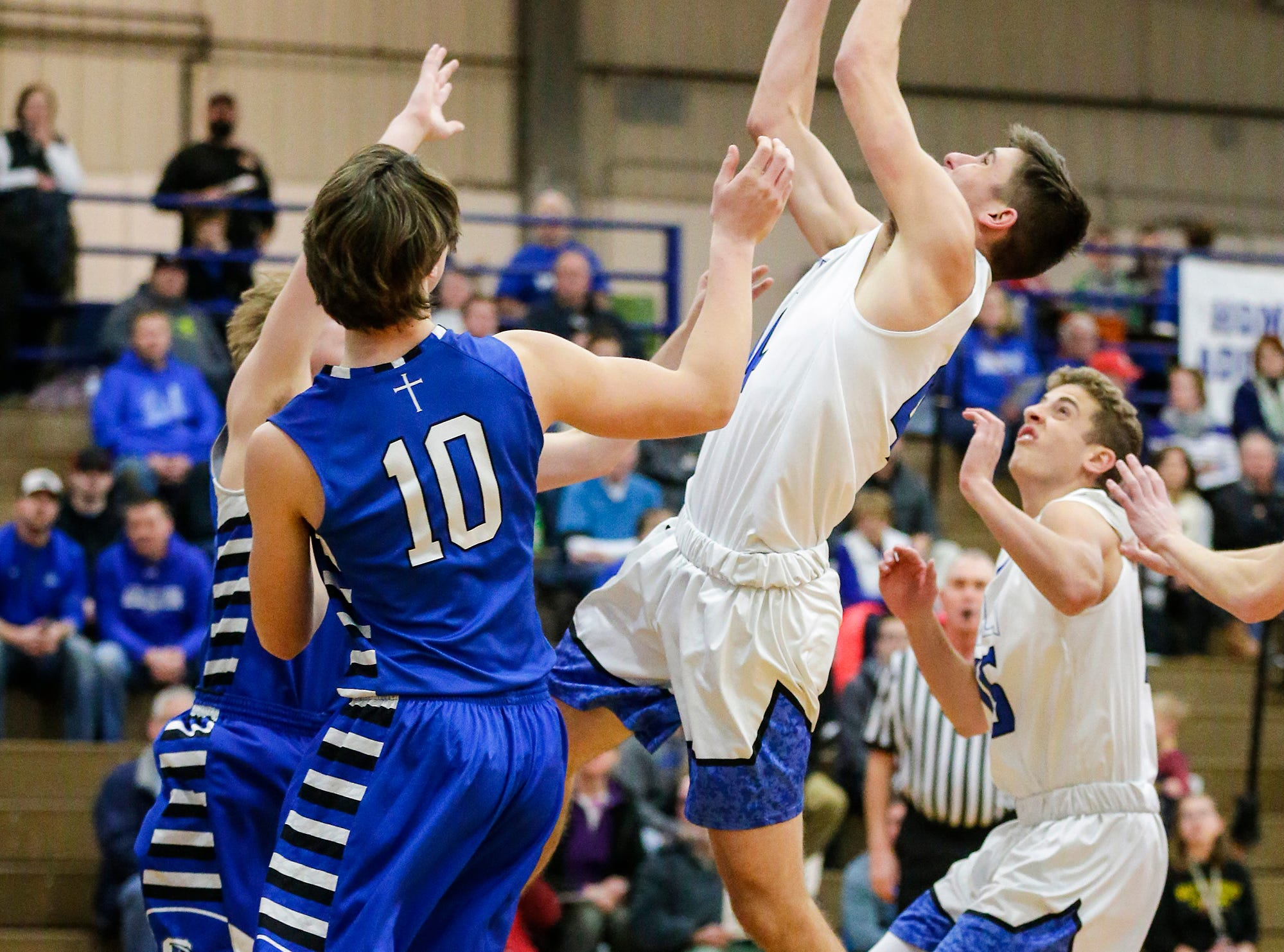 Winnebago Lutheran Academy boys basketball's Benji Cole gets a rebound against St. Mary's Springs Academy Tuesday, January 8, 2019 during their game in Fond du Lac. Winnebago Lutheran Academy won the game 69-66. Doug Raflik/USA TODAY NETWORK-Wisconsin
