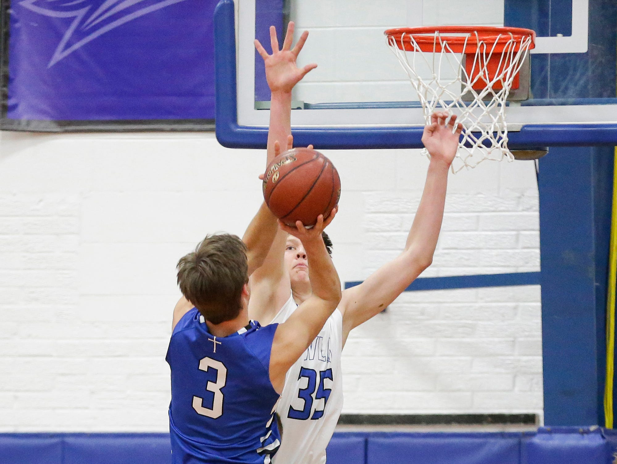 St. Mary's Spring Academy boys basketball's Mitch Waechter attempts a shot against Winnebago Lutheran Academy's Gabe Pruss Tuesday, Jan. 8, 2019, during their game in Fond du Lac. Winnebago Lutheran Academy won the game 69-66.