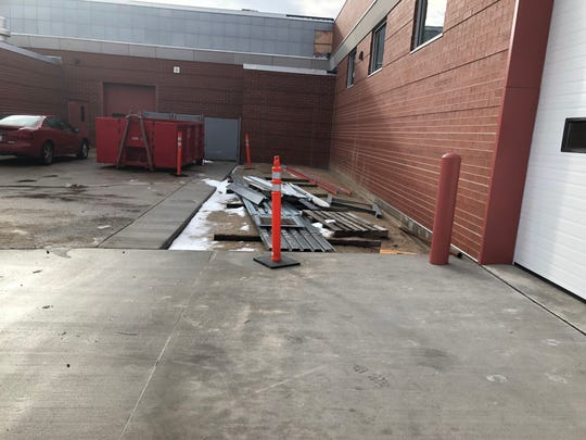 Outside the ACE Academy, students will learn masonry and lay down cement.