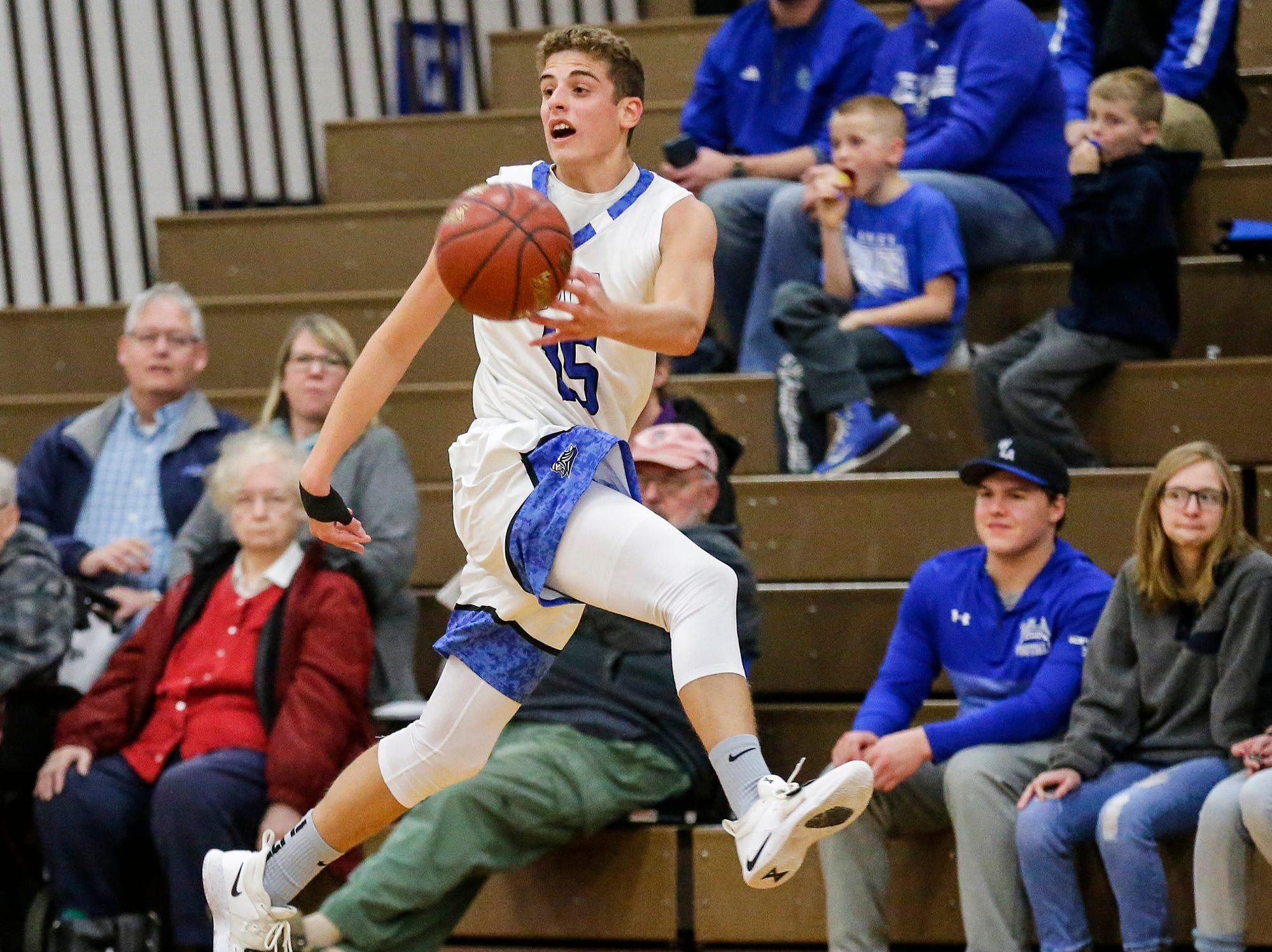 Winnebago Lutheran Academy boys basketball's Zach Loehr saves a ball from going out of bounds against St. Mary's Springs Academy Tuesday, January 8, 2019 during their game in Fond du Lac. Winnebago Lutheran Academy won the game 69-66. Doug Raflik/USA TODAY NETWORK-Wisconsin