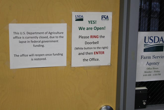 The United States Department of Agriculture's Farm Service Agency office in Sandusky County is closed, with a sign on the door telling residents that it will reopen once the government shutdown ends and funding is restored.