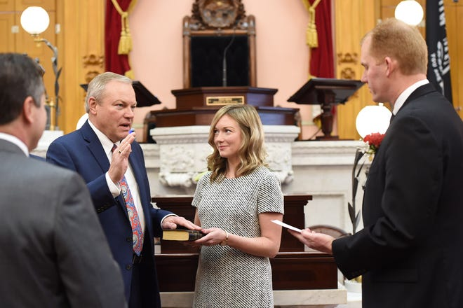 State Rep. Bill Reineke, R-Tiffin, is sworn in to his third term as a member of the Ohio House of Representatives on Jan. 7.