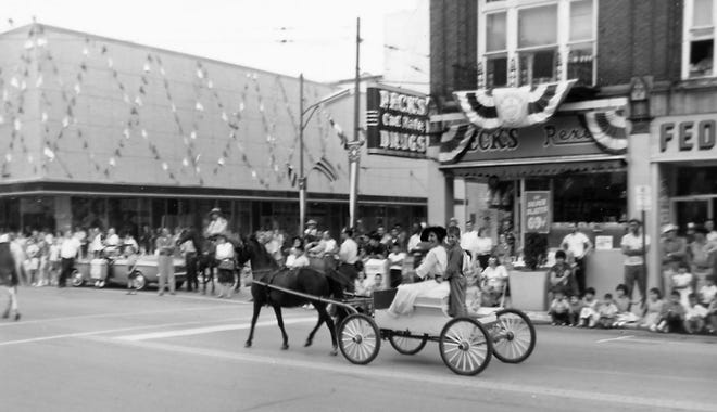 Spectators line Front Street during the Fort Stephenson 150th Anniversary Parade in 1963.