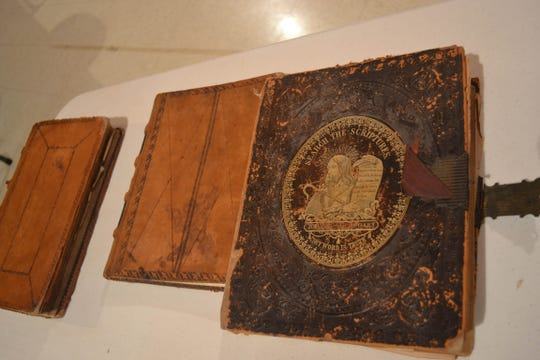 These books, including the first pastor's Bible, were discovered when the church renovated the belfry.