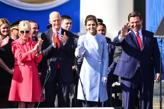 From left to right; outgoing First Lady Ann Scott, outgoing Florida governor Rick Scott, Florida First Lady Casey DeSantis, and Florida governor Ron DeSantis wave to supporters at the Swearing-In Ceremony on the steps of the Old Florida Capitol in Tallahassee on Tuesday.
