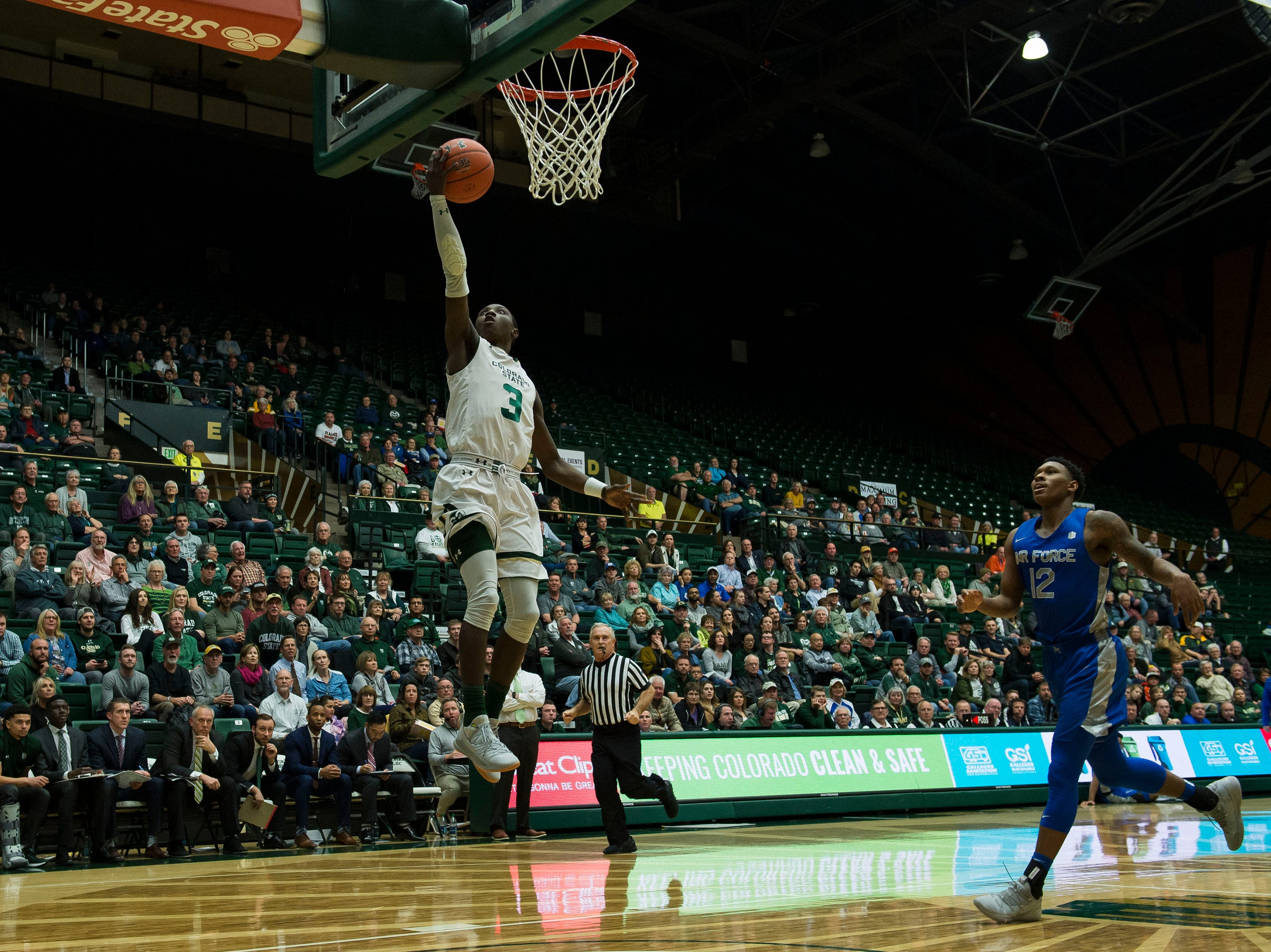 Colorado State University freshman guard Kendle Moore (3) breaks free for a layup off a pass from guard Kris Martin (30) during a game against the Air Force Academy sophomore guard Keaton Van Soelen (44) on Tuesday, Jan. 8, 2019, at Moby Arena in Fort Collins, Colo.