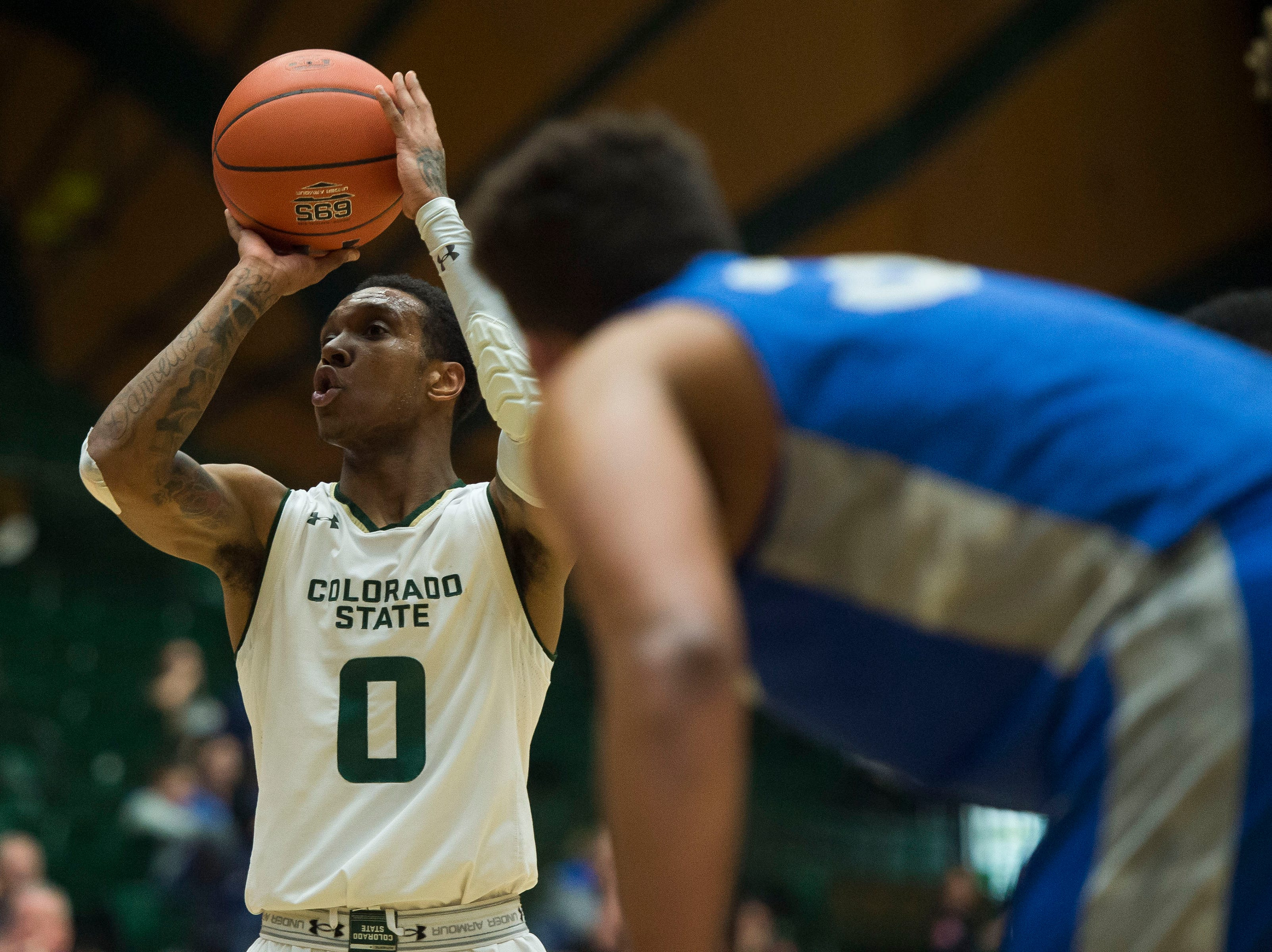 Colorado State University junior guard Hyron Edwards (0) attempts a free throw after drawing a foul from Air Force Academy players on Tuesday, Jan. 8, 2019, at Moby Arena in Fort Collins, Colo.