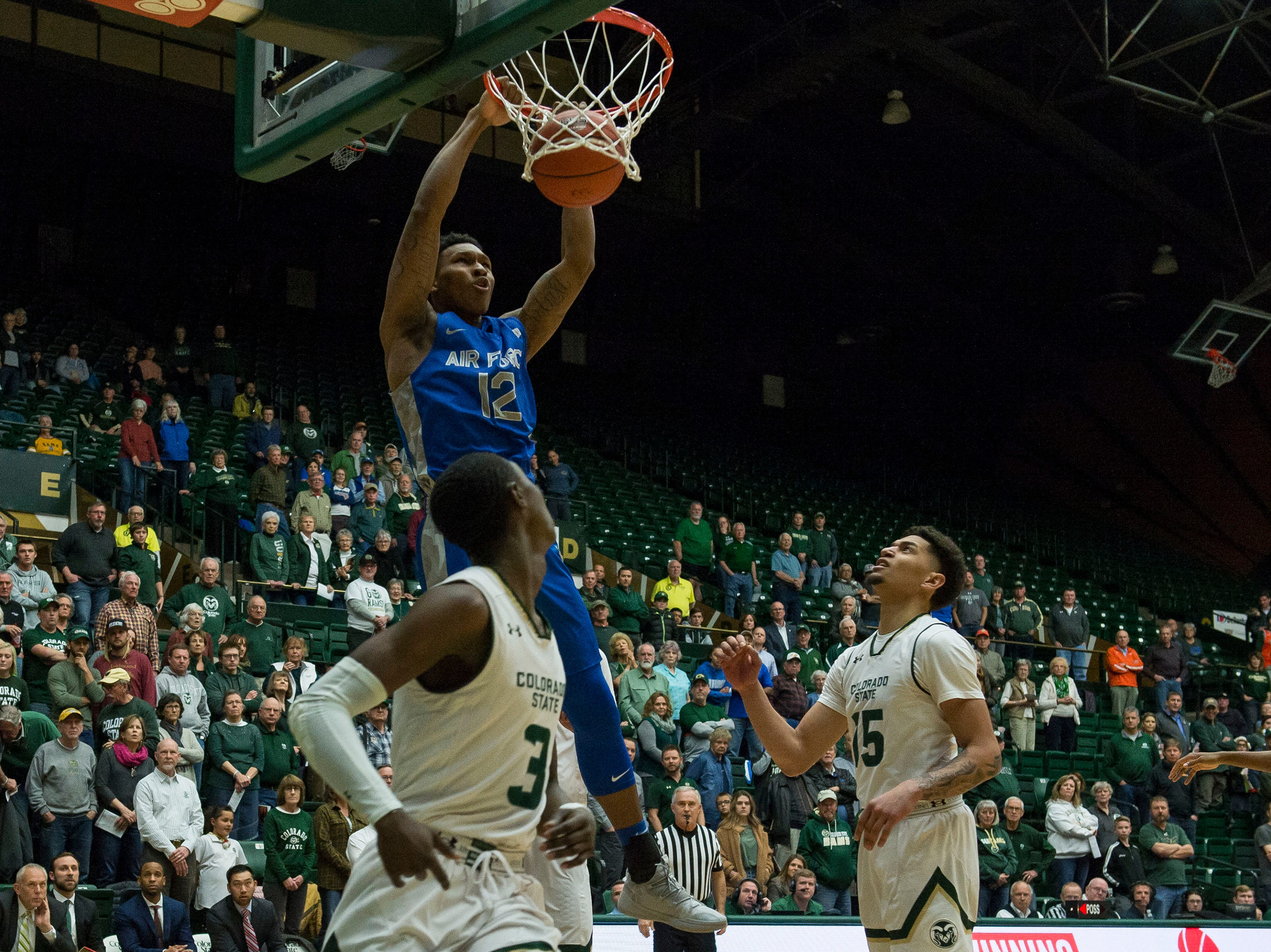 Air Force Academy junior forward Lavelle Scottie (12) dunk during a game against Colorado State University on Tuesday, Jan. 8, 2019, at Moby Arena in Fort Collins, Colo.