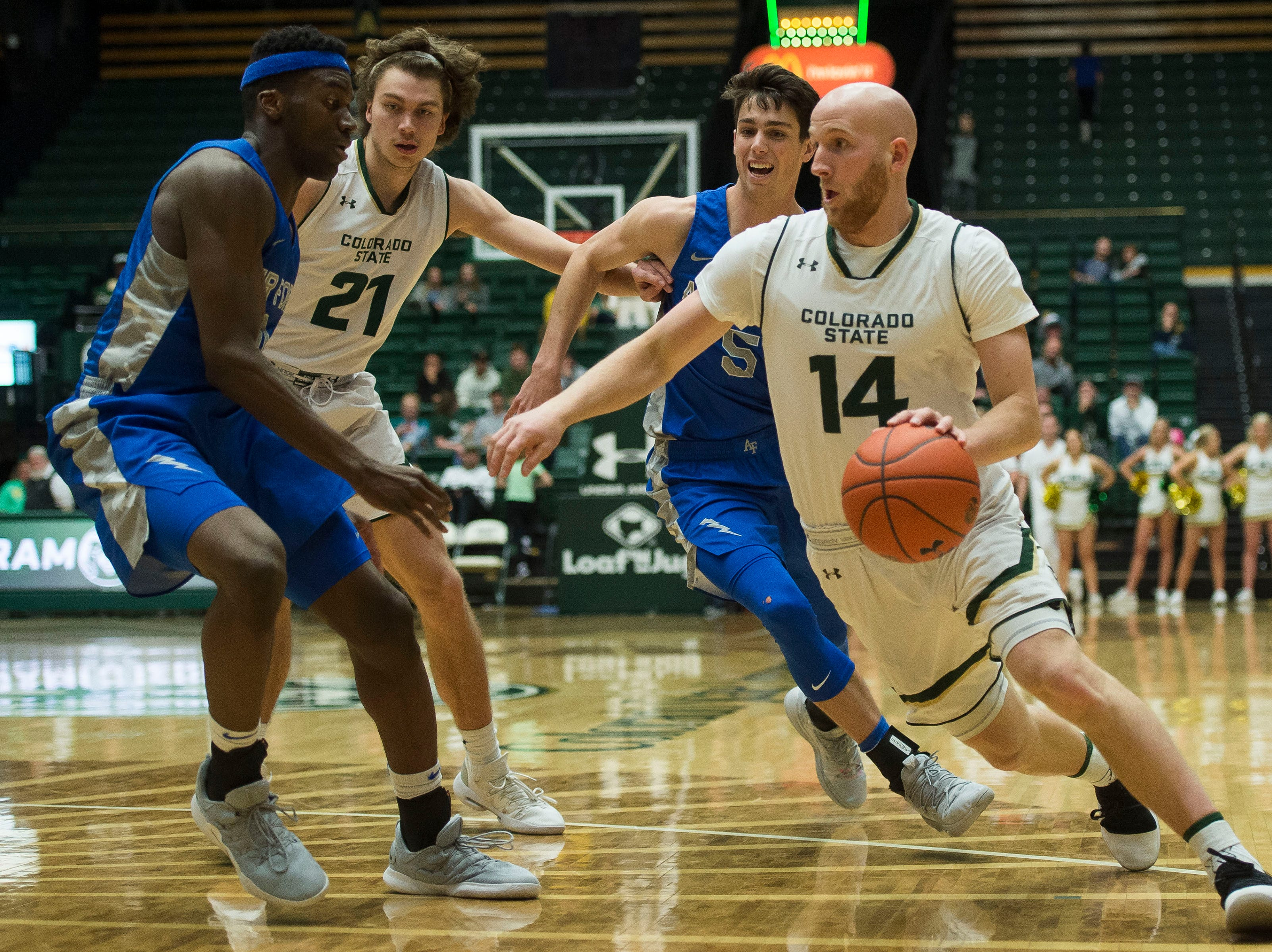 Colorado State University senior guard Robbie Berwick (14) drives into the paint during a game against the Air Force Academy on Tuesday, Jan. 8, 2019, at Moby Arena in Fort Collins, Colo.