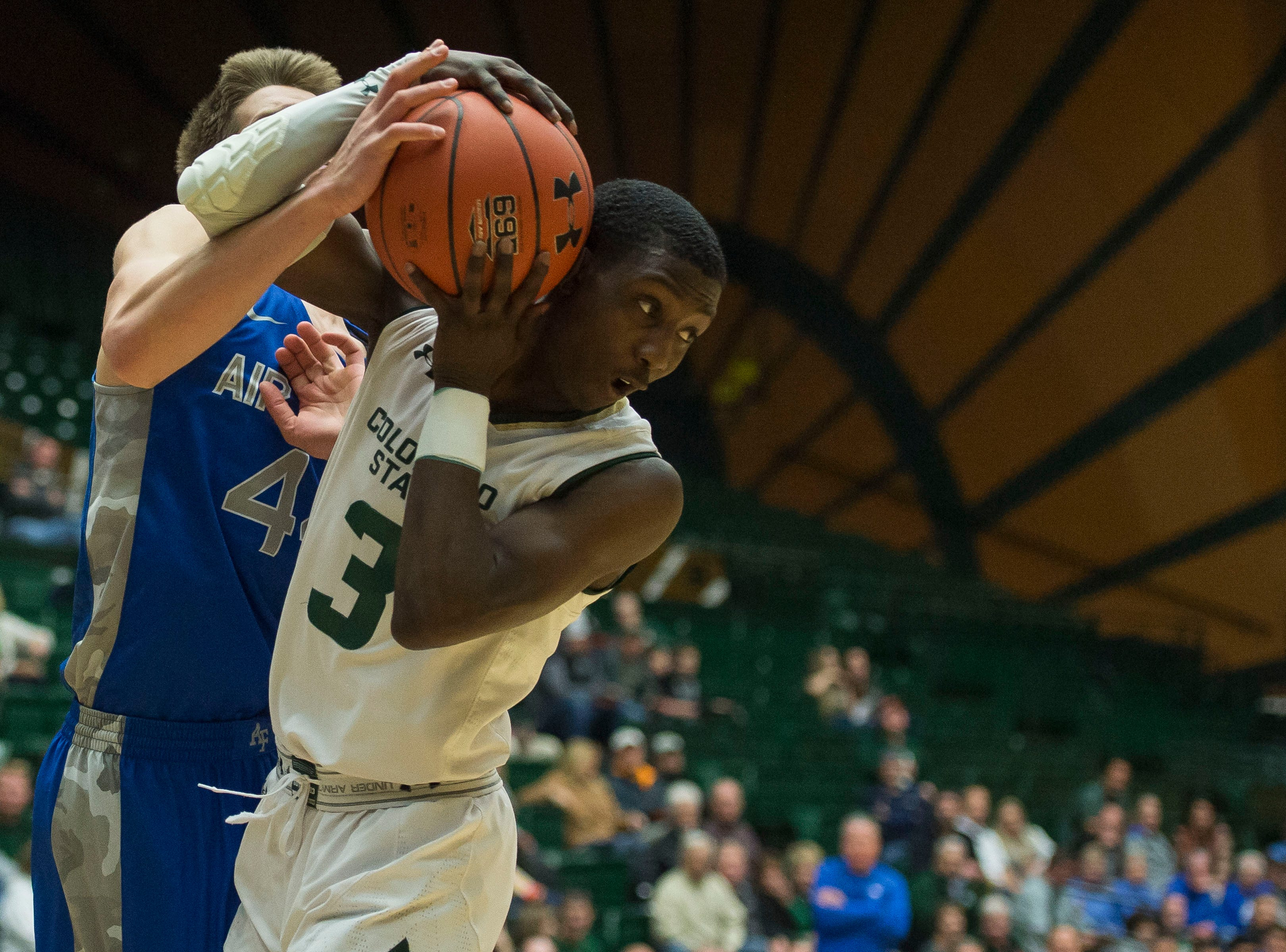 Colorado State University freshman guard Kendle Moore (3) steals the ball from Air Force Academy sophomore guard Keaton Van Soelen (44) on Tuesday, Jan. 8, 2019, at Moby Arena in Fort Collins, Colo.