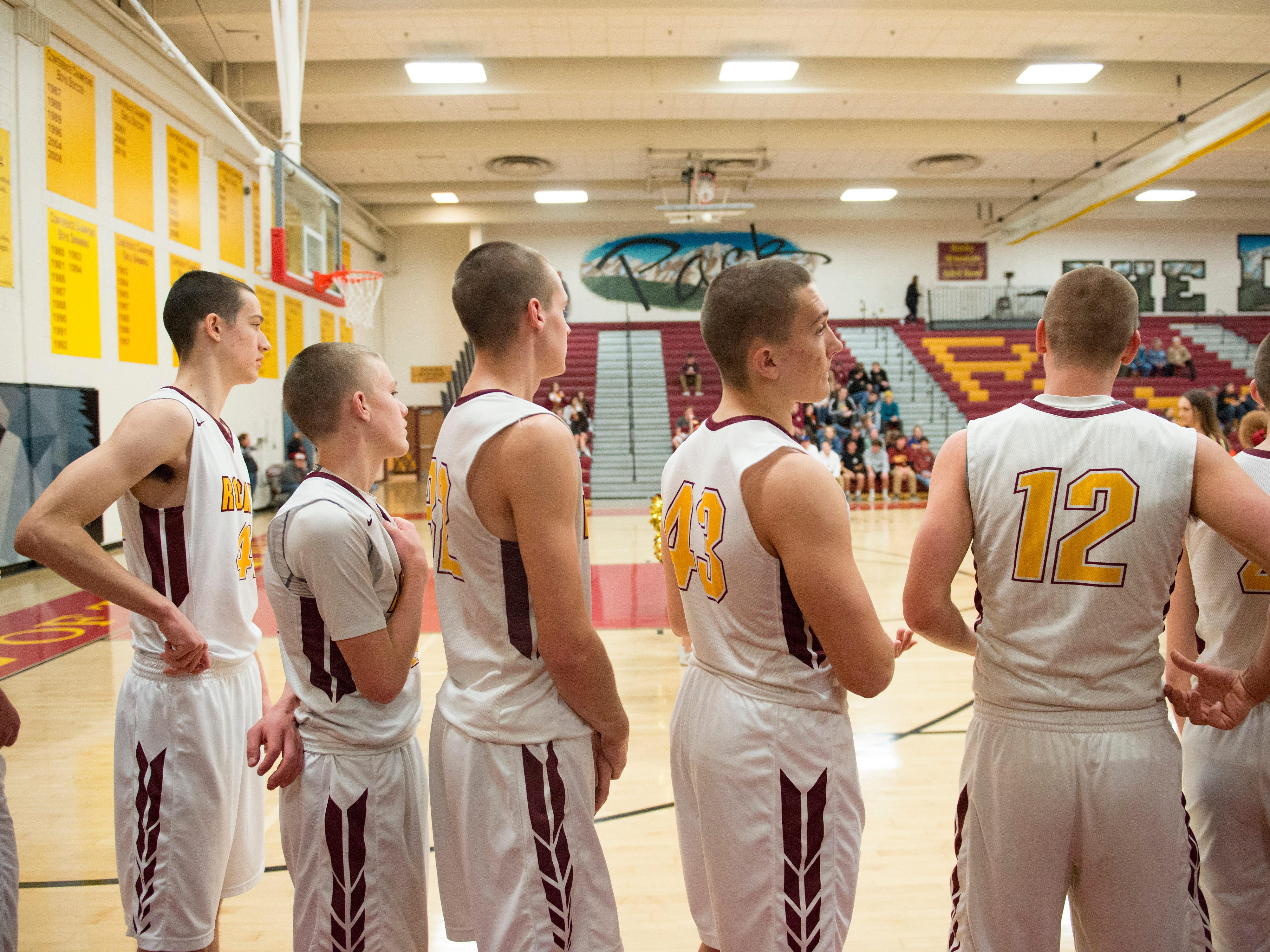The Lobos basketball team lines up for the National Anthem before taking on Greeley West on Tuesday, January 8, 2019. The team shaved their heads a few weeks after finding out their center, Carter Edgerley, was diagnosed with cancer.