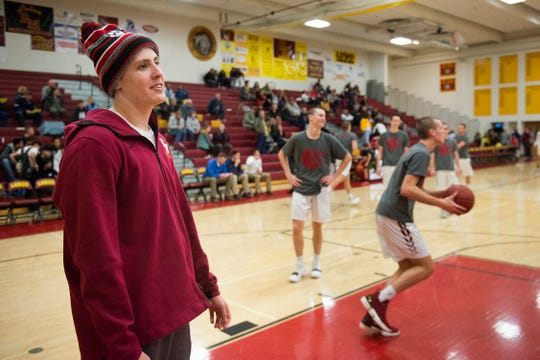 Carter Edgerley watches while the Lobos warm up before taking on Greeley West on Tuesday, January 8, 2019. Carter, a senior at Rocky Mountain High School, was diagnosed with cancer in December and has received an outpour of support from friends, family and teachers.