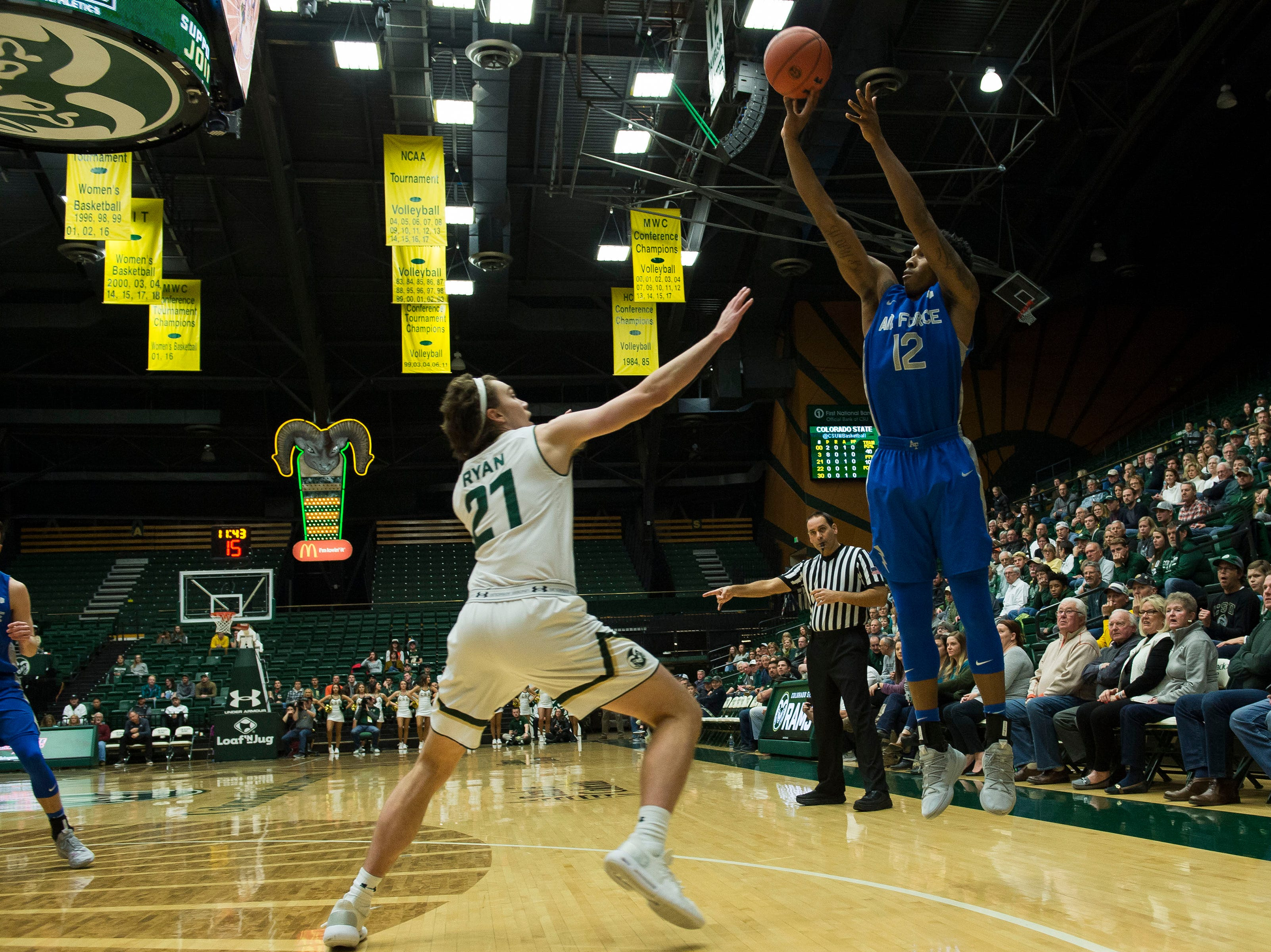 Air Force Academy junior forward Lavelle Scottie (12) takes a long shot against Colorado State University sophomore forward Logan Ryan (21) on Tuesday, Jan. 8, 2019, at Moby Arena in Fort Collins, Colo.