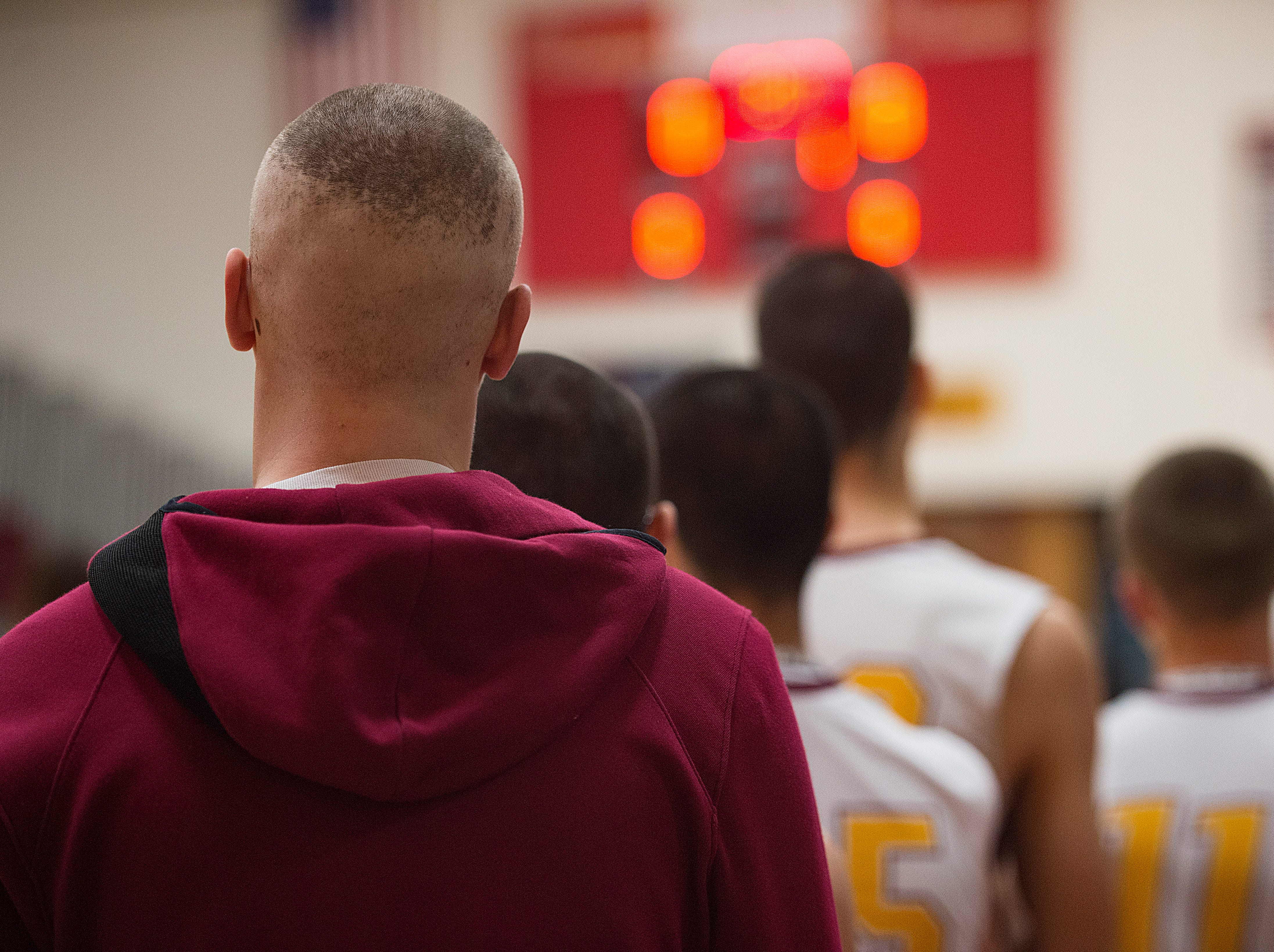 Carter Edgerley lines up with the Lobos during the National Anthem before taking on Greeley West on Tuesday, January 8, 2019.