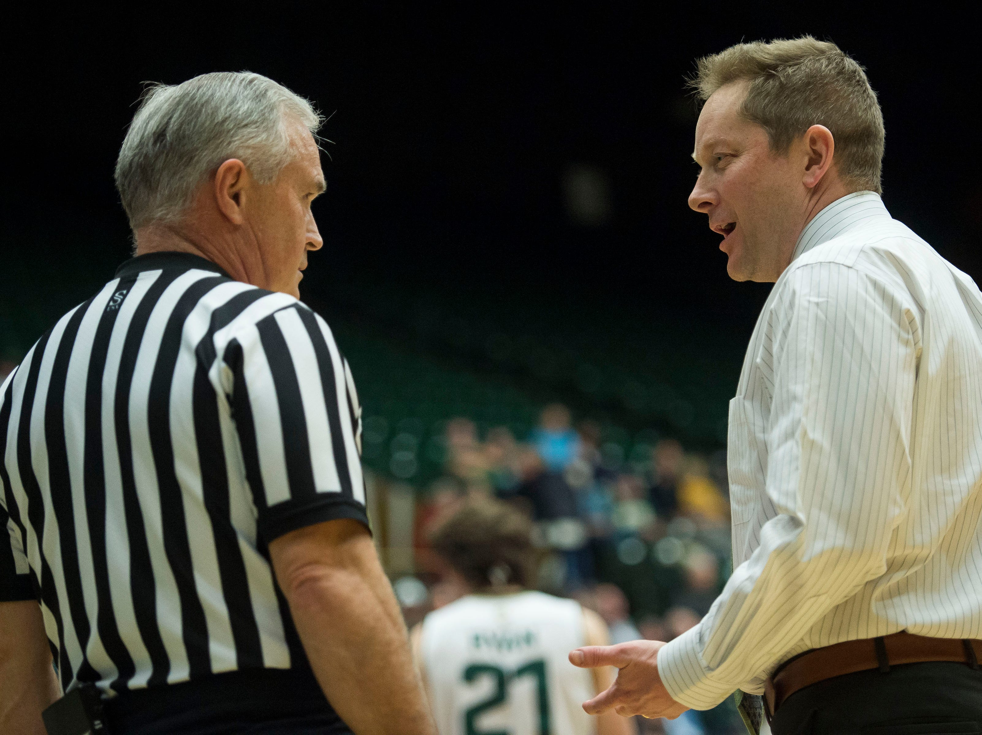 Colorado State University head coach Nico Medved talks with an official during a timeout in a game against the Air Force Academy on Tuesday, Jan. 8, 2019, at Moby Arena in Fort Collins, Colo.