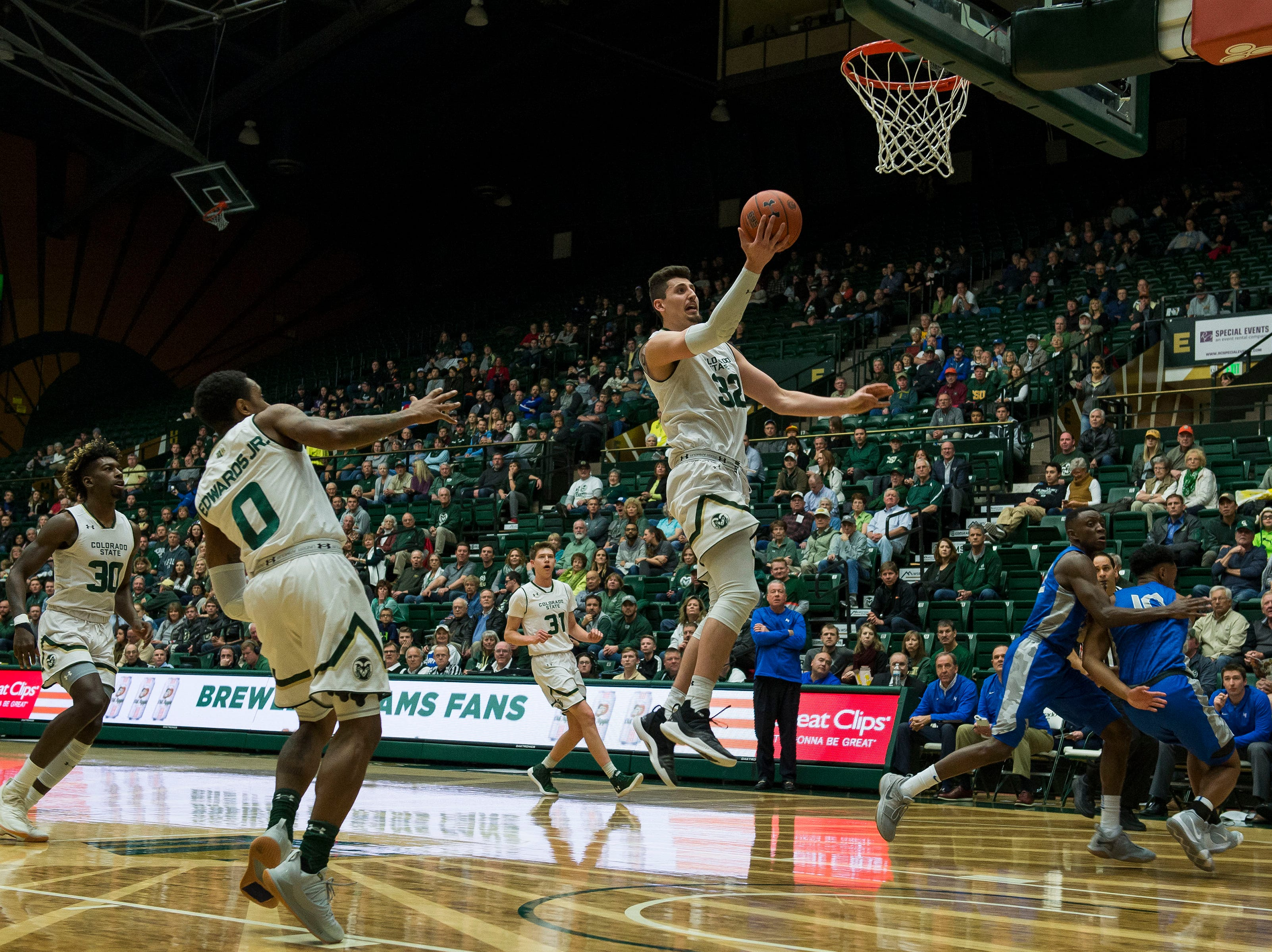 Colorado State University junior center Nico Carvacho (32) breaks free for a layup against the Air Force Academy on Tuesday, Jan. 8, 2019, at Moby Arena in Fort Collins, Colo.