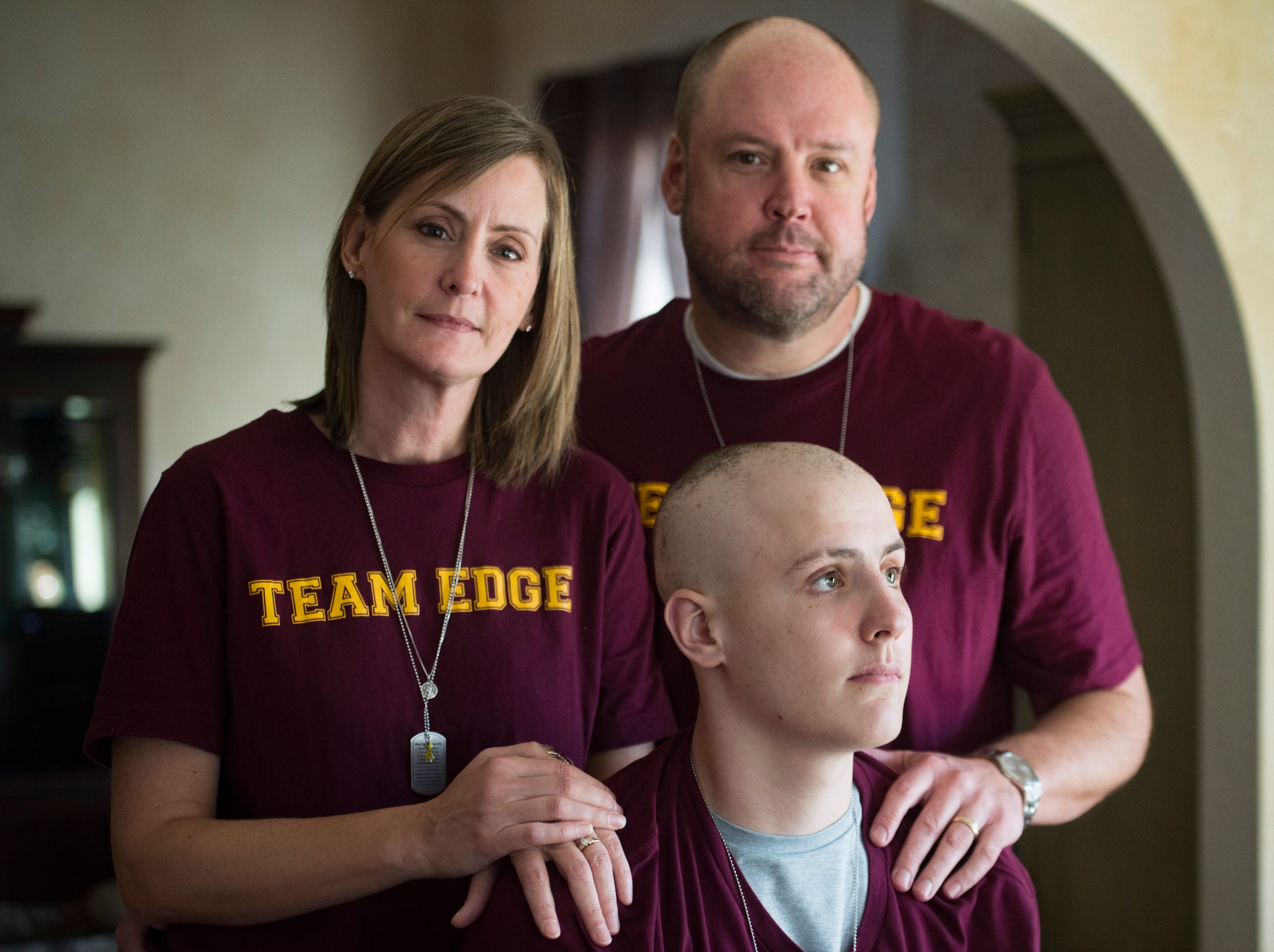 Michelle and Michael Edgerley pose for a photo with their son, Carter, 17, at their home in Fort Collins on Tuesday, January 8, 2019. Carter, a senior at Rocky Mountain High School, was diagnosed with cancer in December and has received an outpour of support from friends, family and teachers.