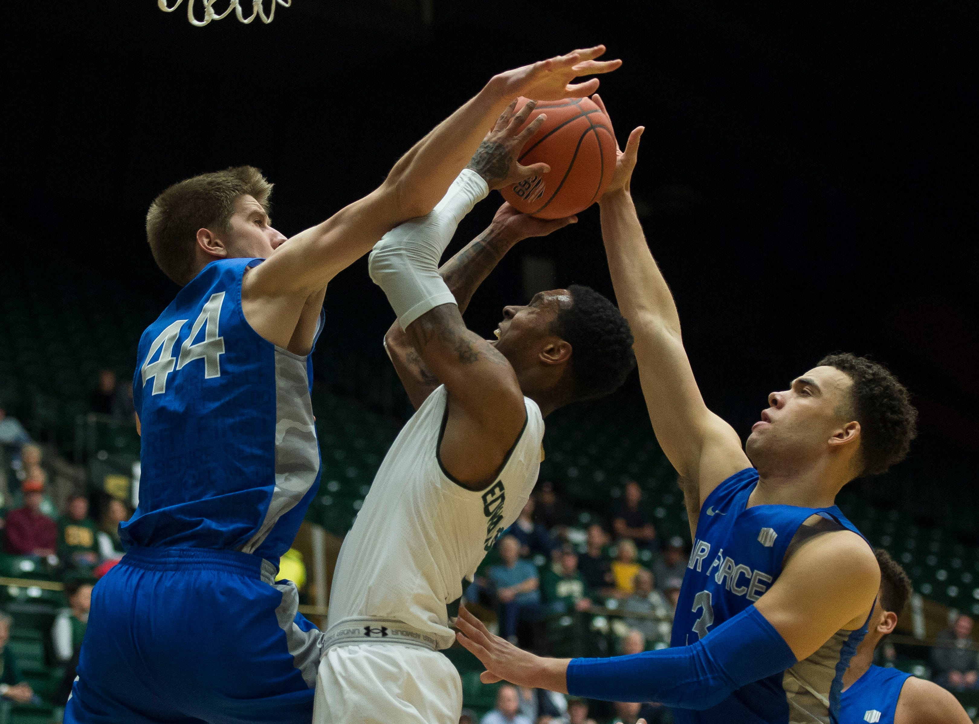 Colorado State University junior guard Hyron Edwards (0) draws the foul from Air Force Academy players on Tuesday, Jan. 8, 2019, at Moby Arena in Fort Collins, Colo.