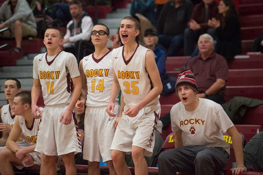 Carter Edgerley cheers for his teammates on the Rocky Mountain High School basketball team from the bench after a Lobos play in a game against Greeley West on Tuesday, January 8, 2019. The Lobos lost the game to Spartans 63-53.