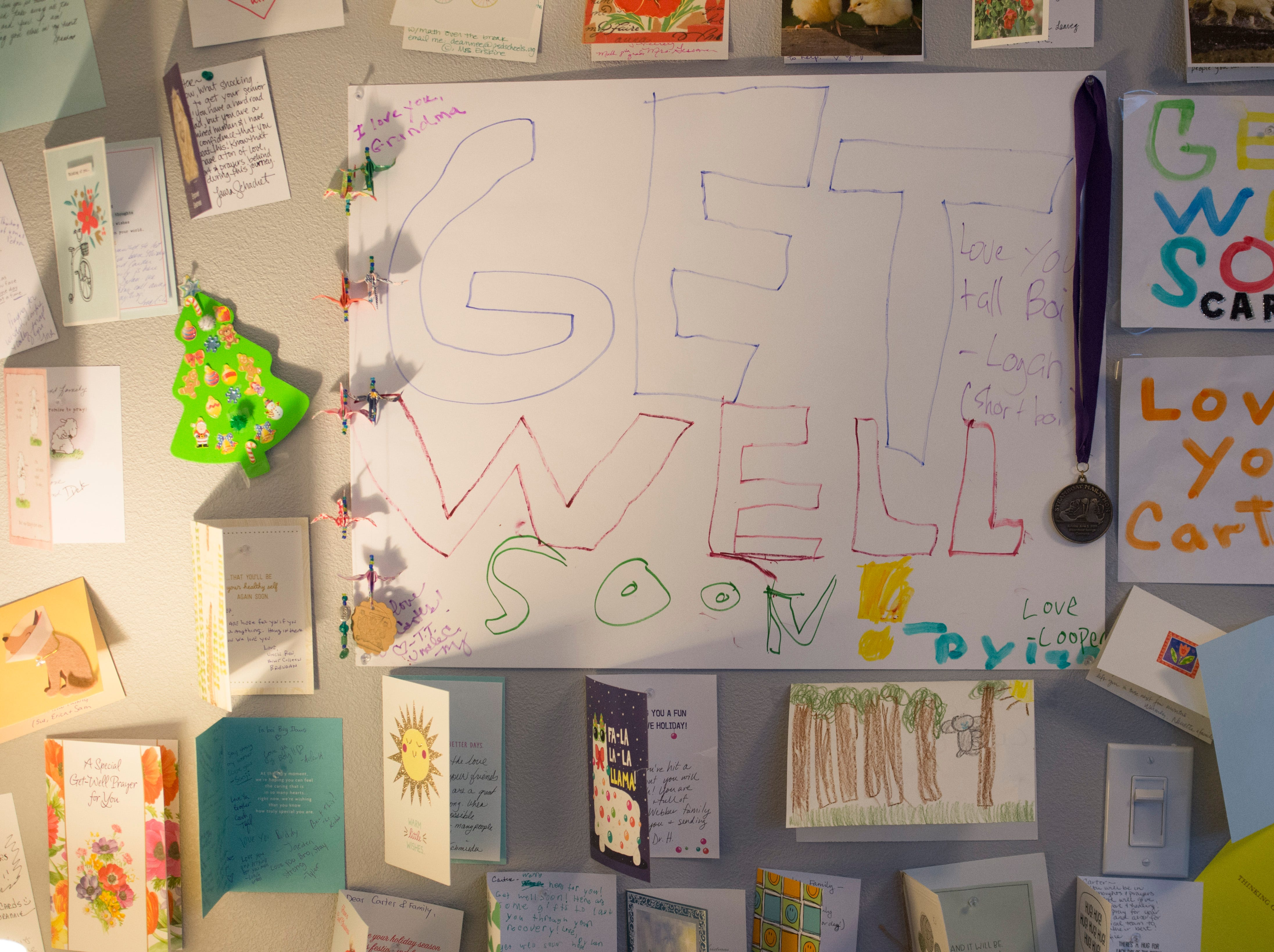 Cards are posted on the wall in the room of Carter Edgerley, 17, at his home in Fort Collins on Tuesday, January 8, 2019. Edgerley, a senior at Rocky Mountain High School was diagnosed with cancer in December.