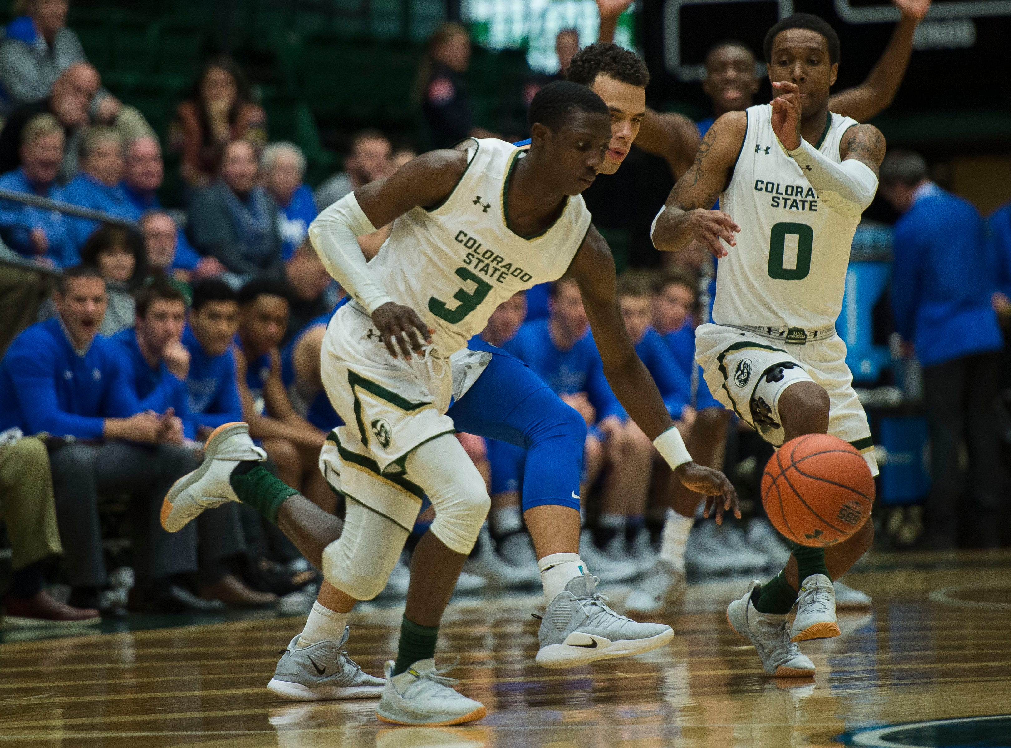 Colorado State University freshman guard Kendle Moore (3) steals the ball from Air Force Academy junior guard Sid Tomes (3) on Tuesday, Jan. 8, 2019, at Moby Arena in Fort Collins, Colo.