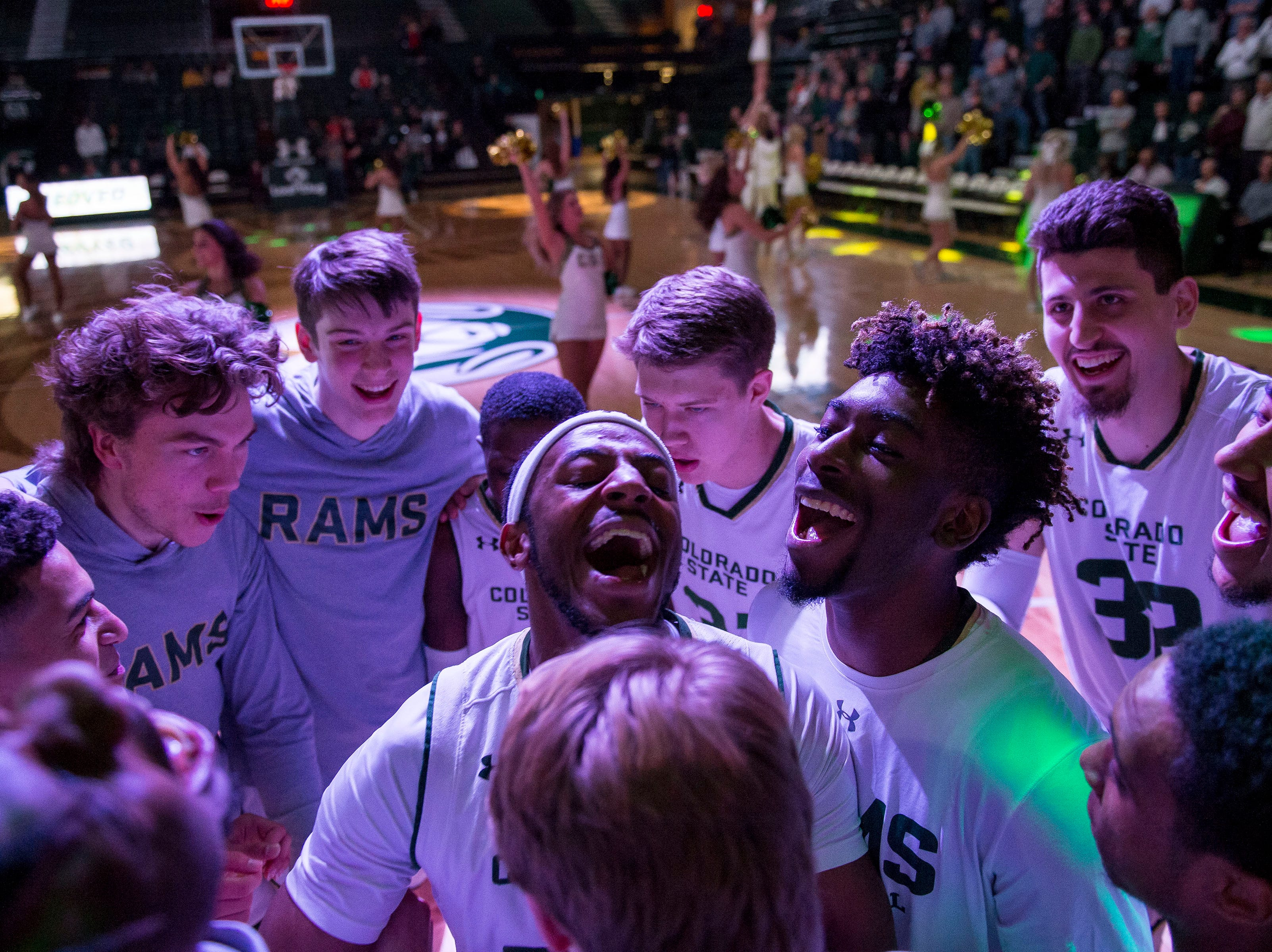 The Colorado State University basketball team gets hyped up on the court before a game against the Air Force Academy on Tuesday, Jan. 8, 2019, at Moby Arena in Fort Collins, Colo.