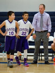 Oasis head coach Robert Ebbert has been a huge part of the development of now seniors Taylon Hutchins (22) and Kylar Frias (10) dating back to middle school.