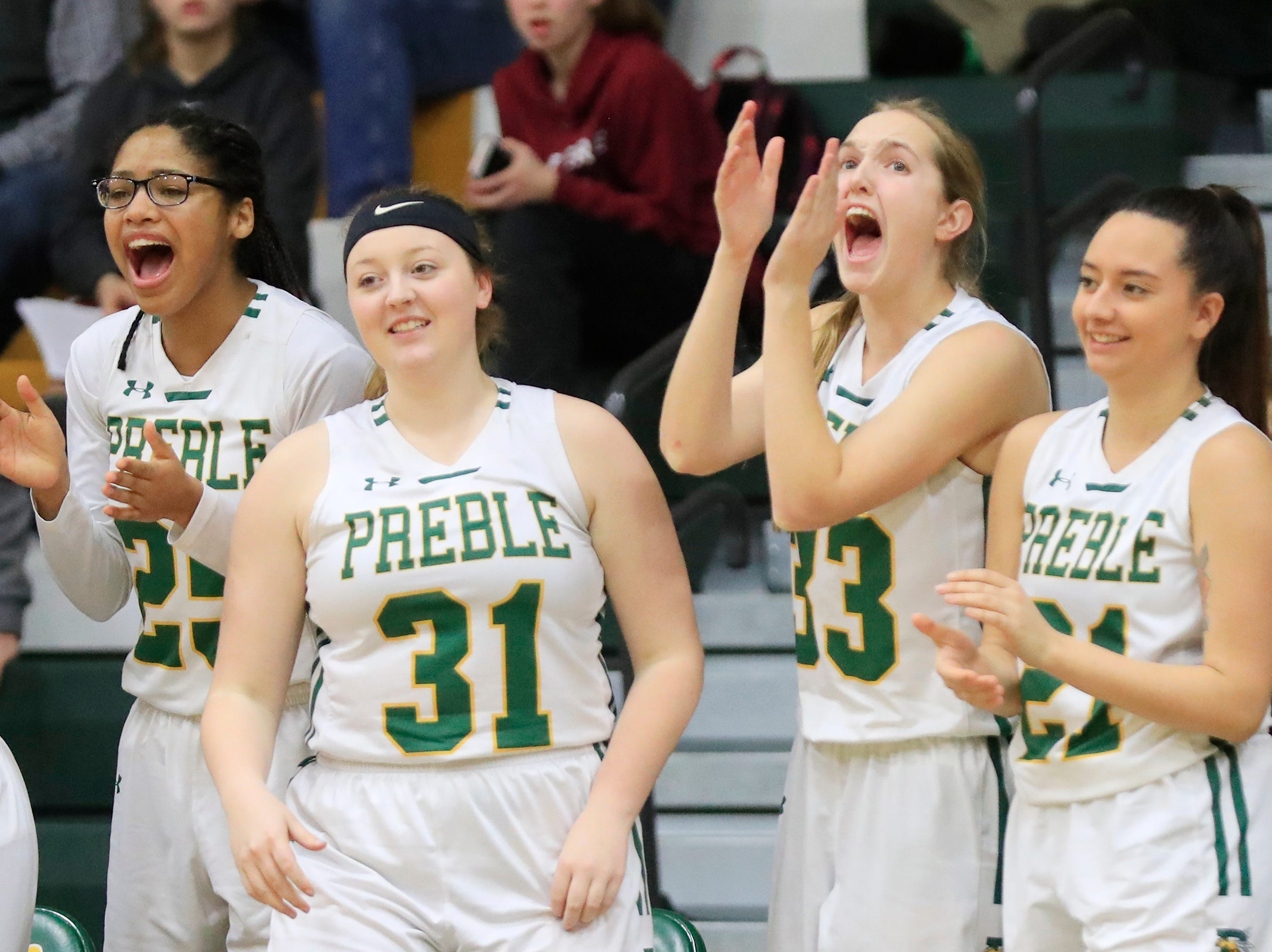 Green Bay Preble players celebrate from the bench against De Pere in a girls basketball game at Preble high school on Tuesday, January 8, 2019 in Green Bay, Wis.