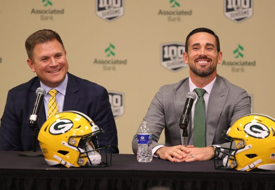 New Green Bay Packers head coach Matt LaFleur, right, laughs with general manager Brian Gutekunst as LaFleur is introduced during a press conference in the Lambeau Field media auditorium Wednesday, January 9, 2019 in Green Bay, Wis.