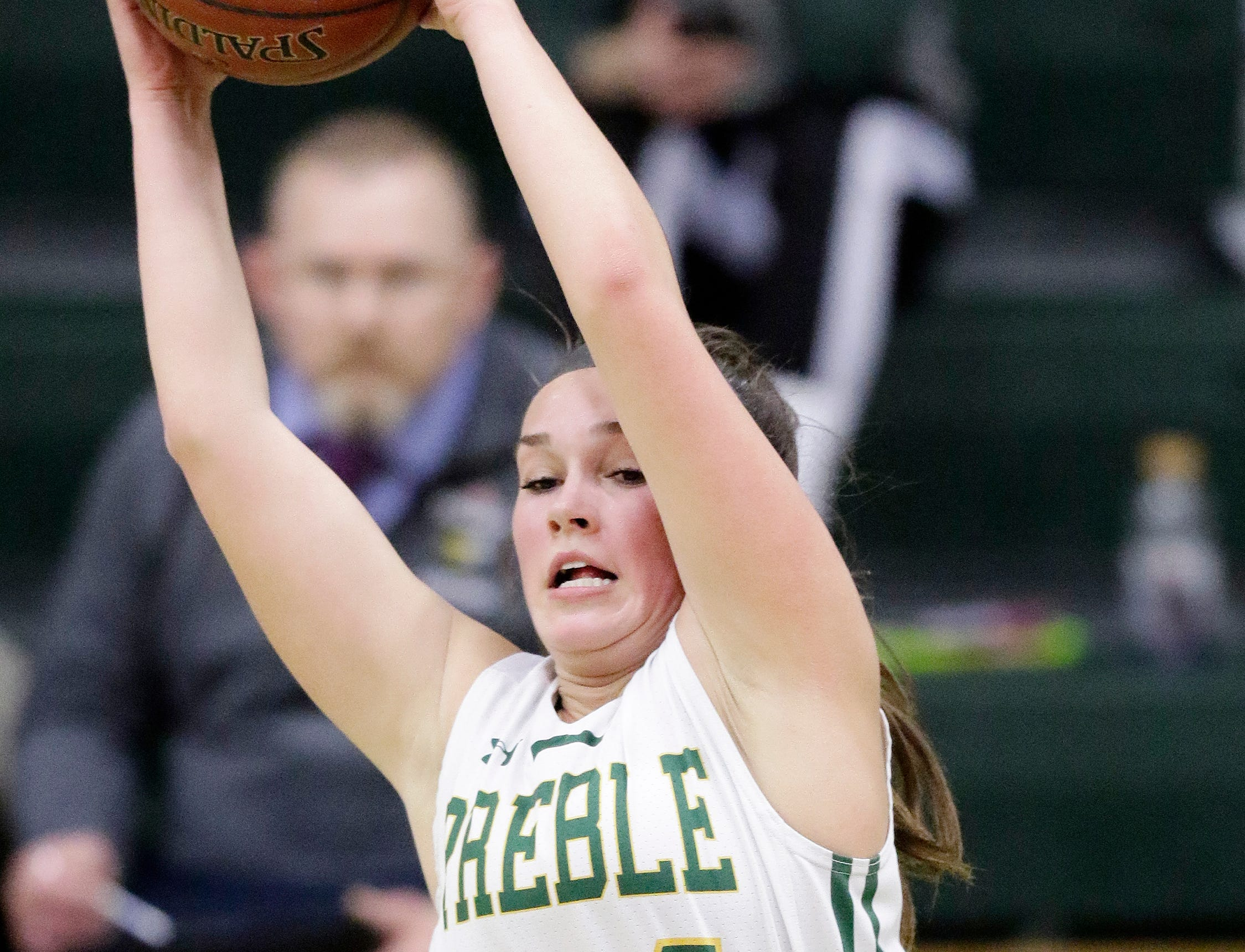 Green Bay Preble's Ella Bialkowski (24) receives a pass under the hoop against De Pere in a girls basketball game at Preble high school on Tuesday, January 8, 2019 in Green Bay, Wis.