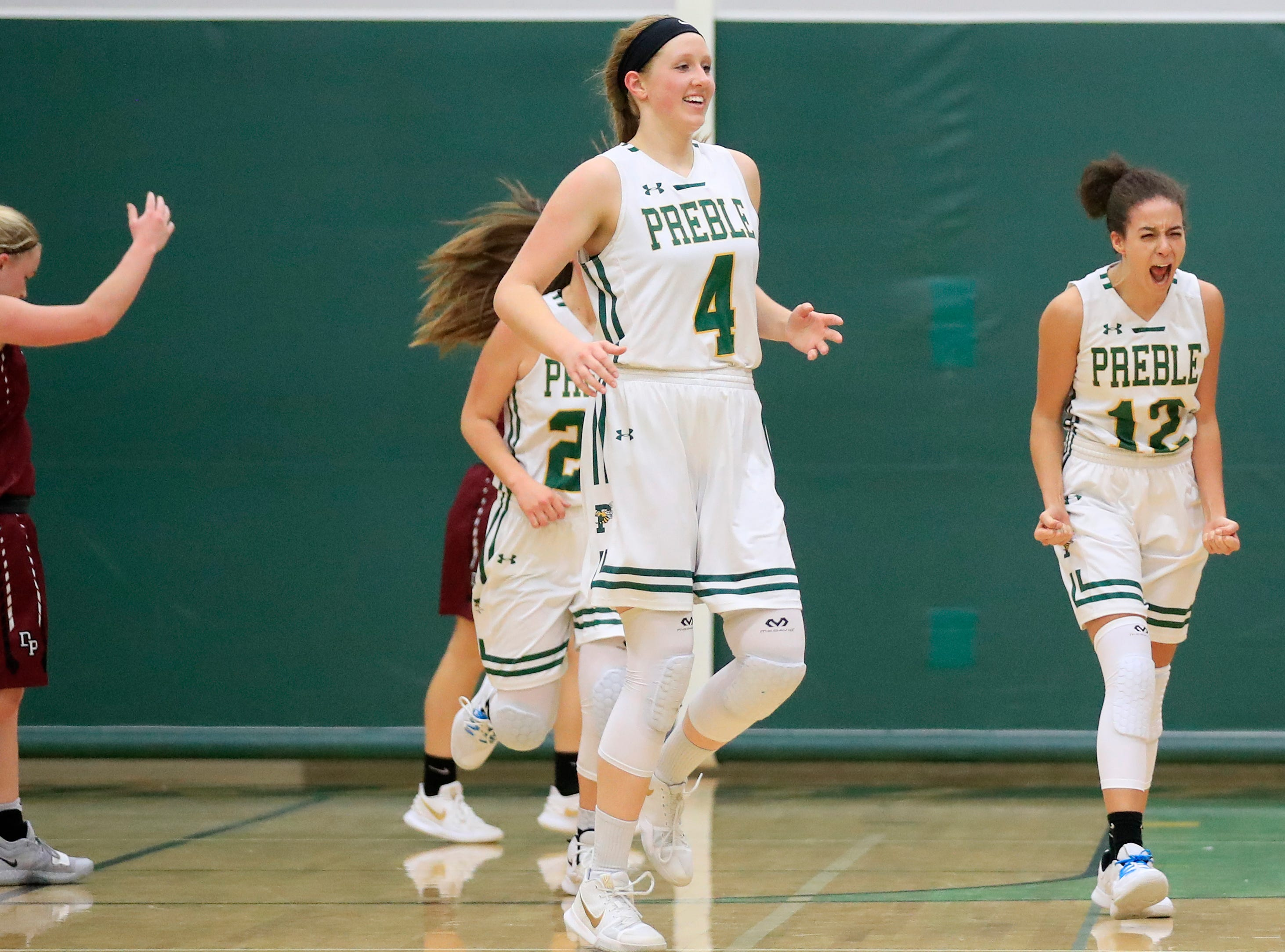 Green Bay Preble's Hannah Beauchamp (12) and Kendall Renard (4) celebrate after defeating De Pere in a girls basketball game at Preble high school on Tuesday, January 8, 2019 in Green Bay, Wis.