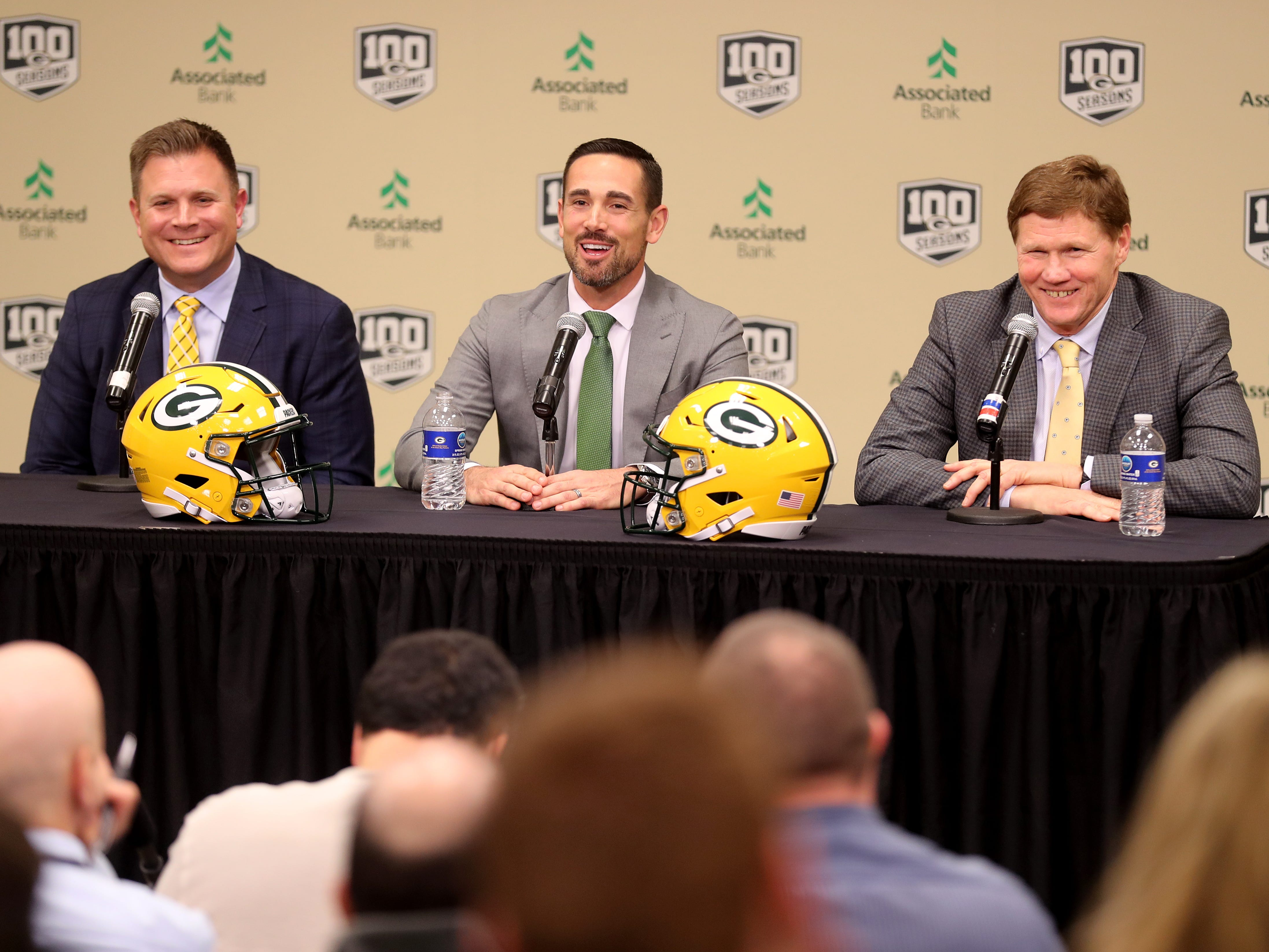 New Green Bay Packers head coach Matt LaFleur, center,  is introduced during a press conference in the Lambeau Field media auditorium with general manager Brian Gutekunst, left, and team president Mark Murphy Wednesday, January 9, 2019 in Green Bay, Wis.