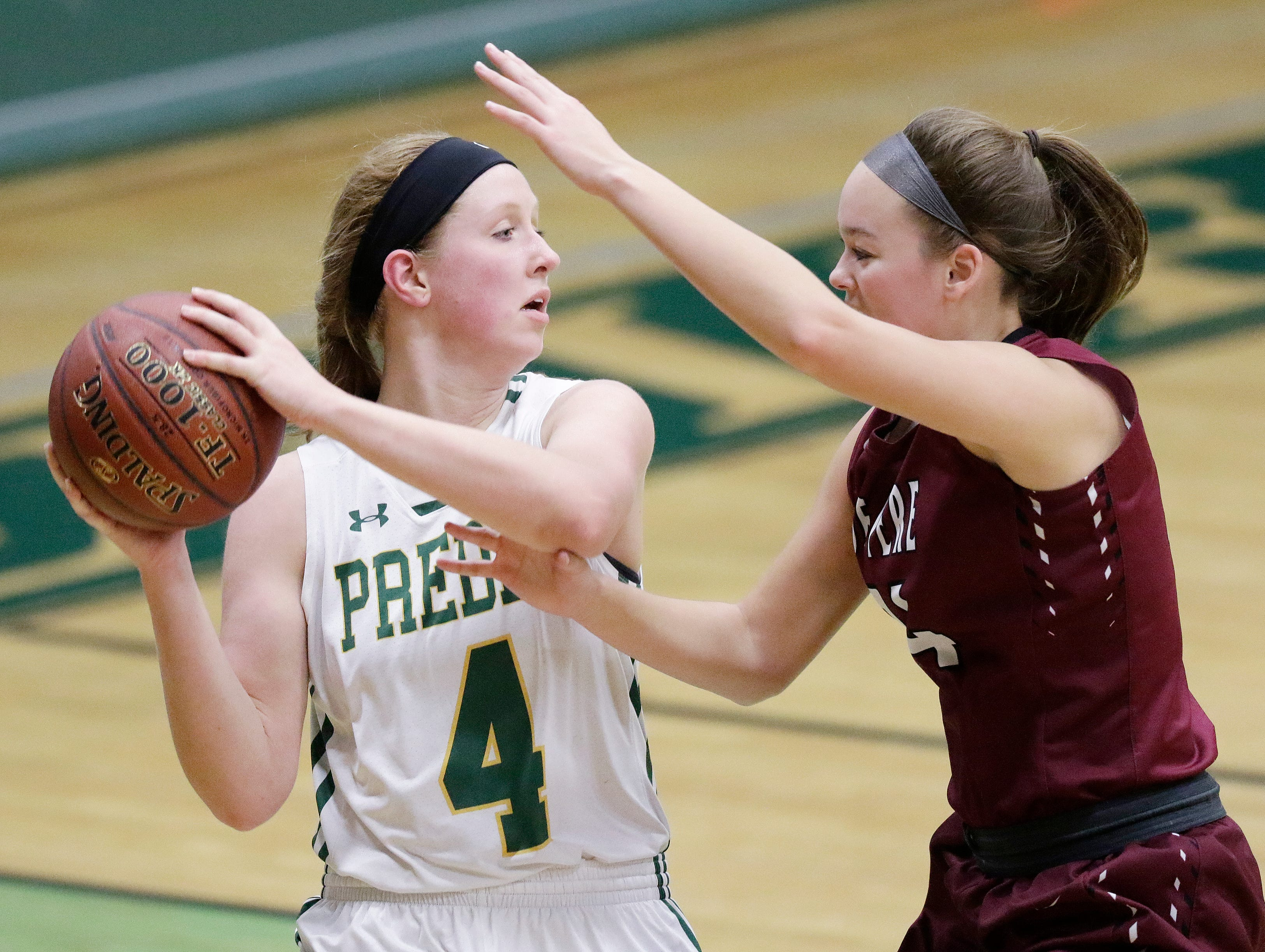 Green Bay Preble's Kendall Renard (4) is pressured by De Pere's Sophia McCarty (24) in a girls basketball game at Preble high school on Tuesday, January 8, 2019 in Green Bay, Wis.