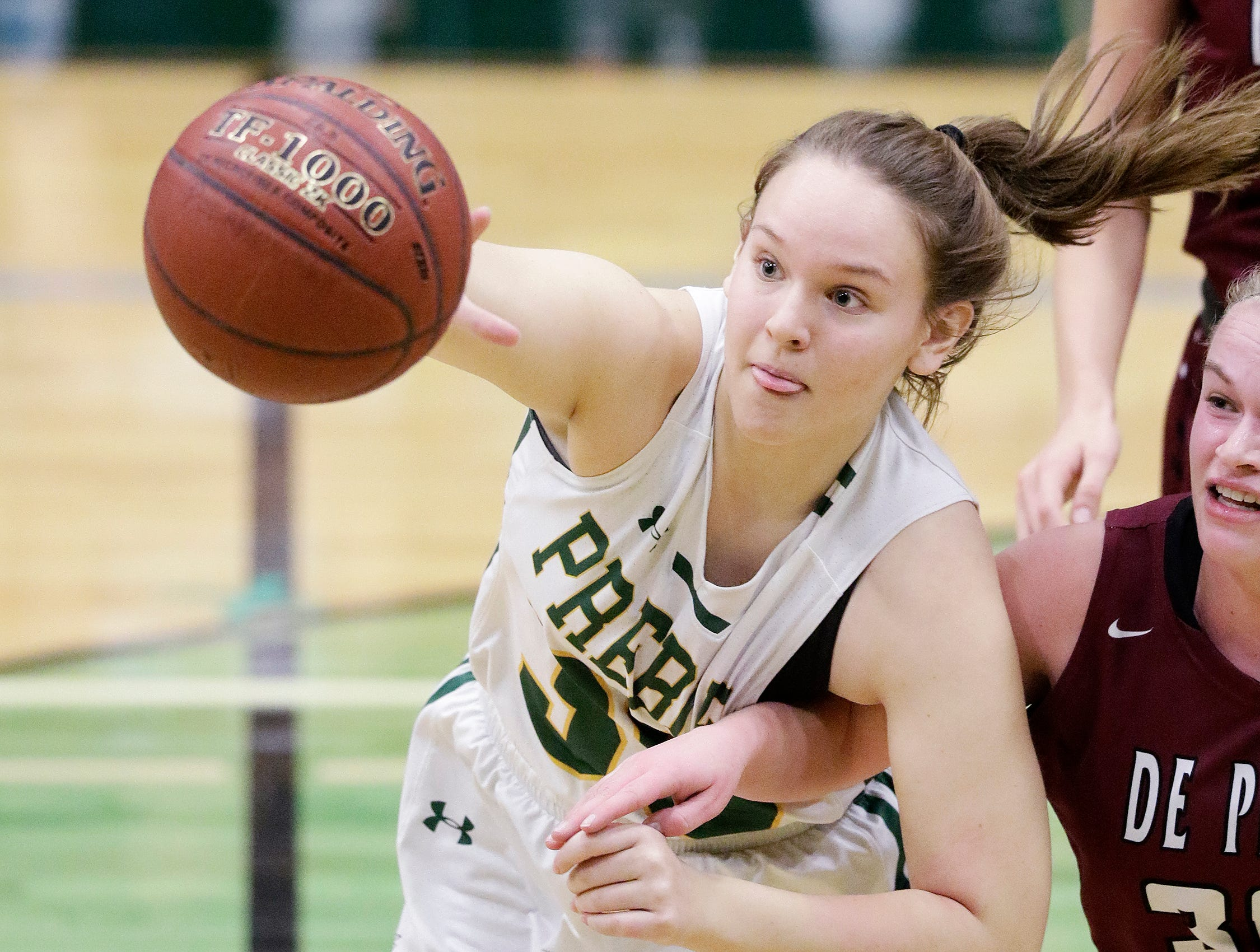 Green Bay Preble's Samantha Voelker (30) grabs a rebound ahead of De Pere's Rachel Kerkhoff (30) in a girls basketball game at Preble high school on Tuesday, January 8, 2019 in Green Bay, Wis.