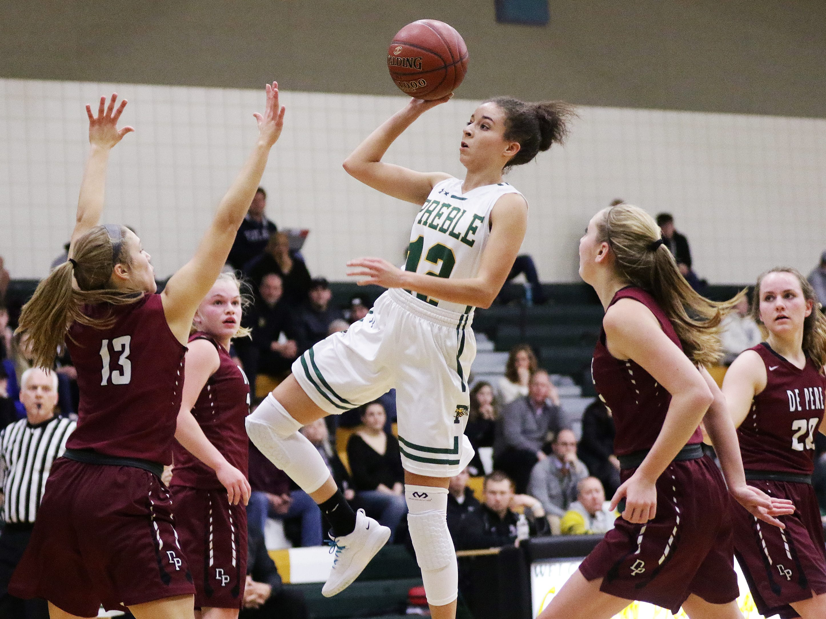 Green Bay Preble's Hannah Beauchamp (12) shoots against De Pere in a girls basketball game at Preble high school on Tuesday, January 8, 2019 in Green Bay, Wis.