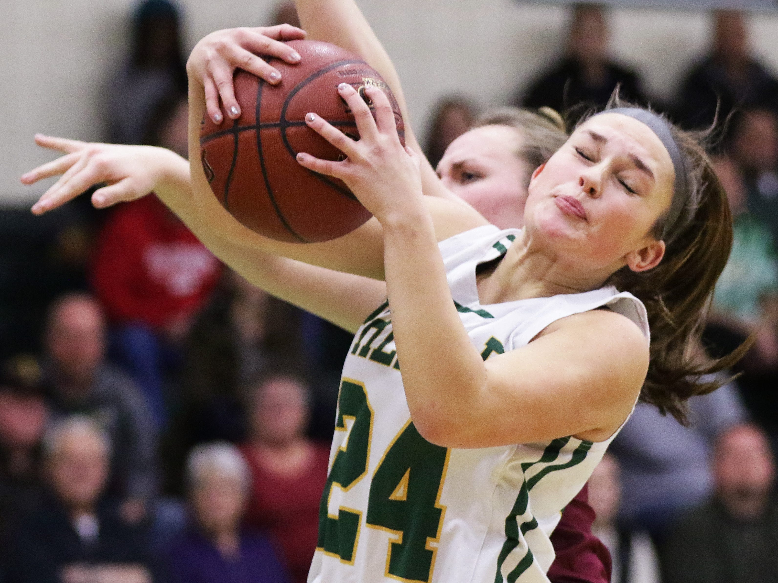 Green Bay Preble's Ella Bialkowski (24) grabs a rebound against De Pere in a girls basketball game at Preble high school on Tuesday, January 8, 2019 in Green Bay, Wis.