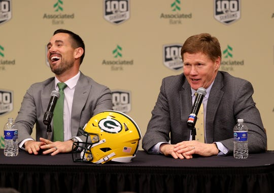 New Green Bay Packers head coach Matt LaFleur laughs as team president Mark Murphy, right, utters an expletive as LaFleur is introduced during a press conference in the Lambeau Field media auditorium Wednesday, January 9, 2019 in Green Bay, Wis.