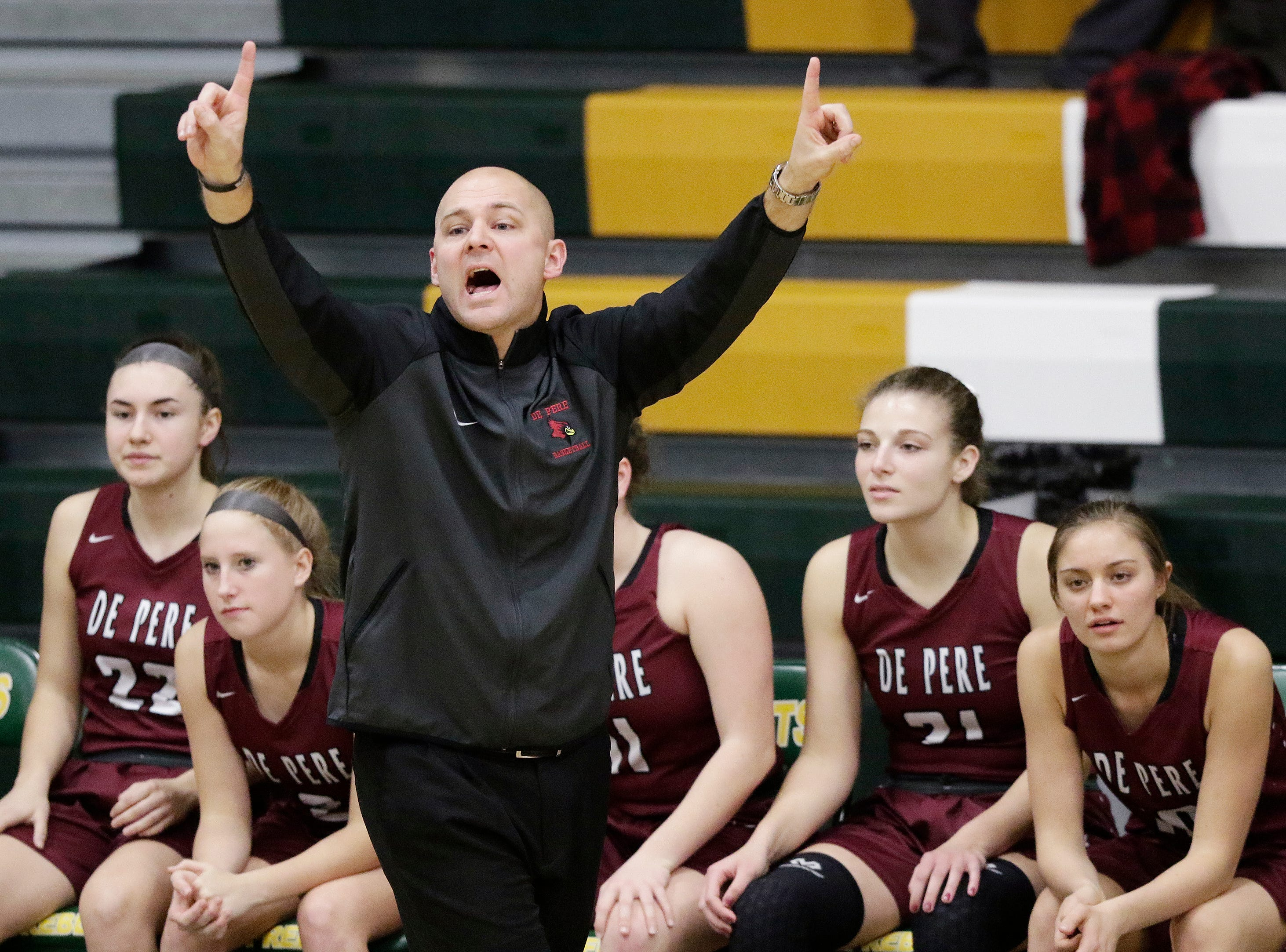De Pere head coach Jeremy Boileau reacts in a girls basketball game against Green Bay Preble at Preble high school on Tuesday, January 8, 2019 in Green Bay, Wis.
