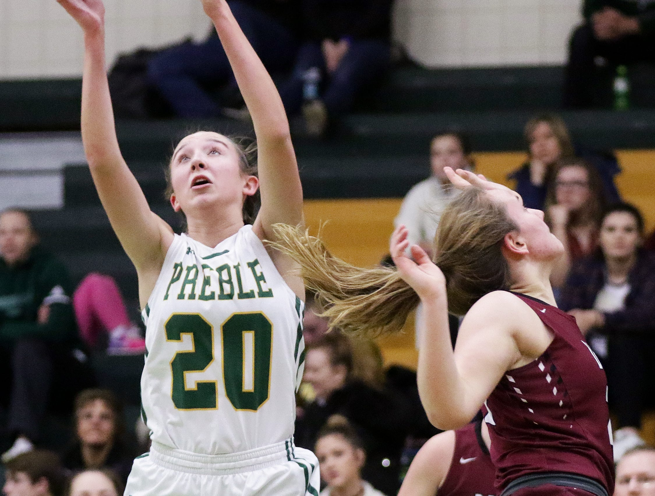 Green Bay Preble's Carley Duffney (20) grabs a rebound against De Pere in a girls basketball game at Preble high school on Tuesday, January 8, 2019 in Green Bay, Wis.