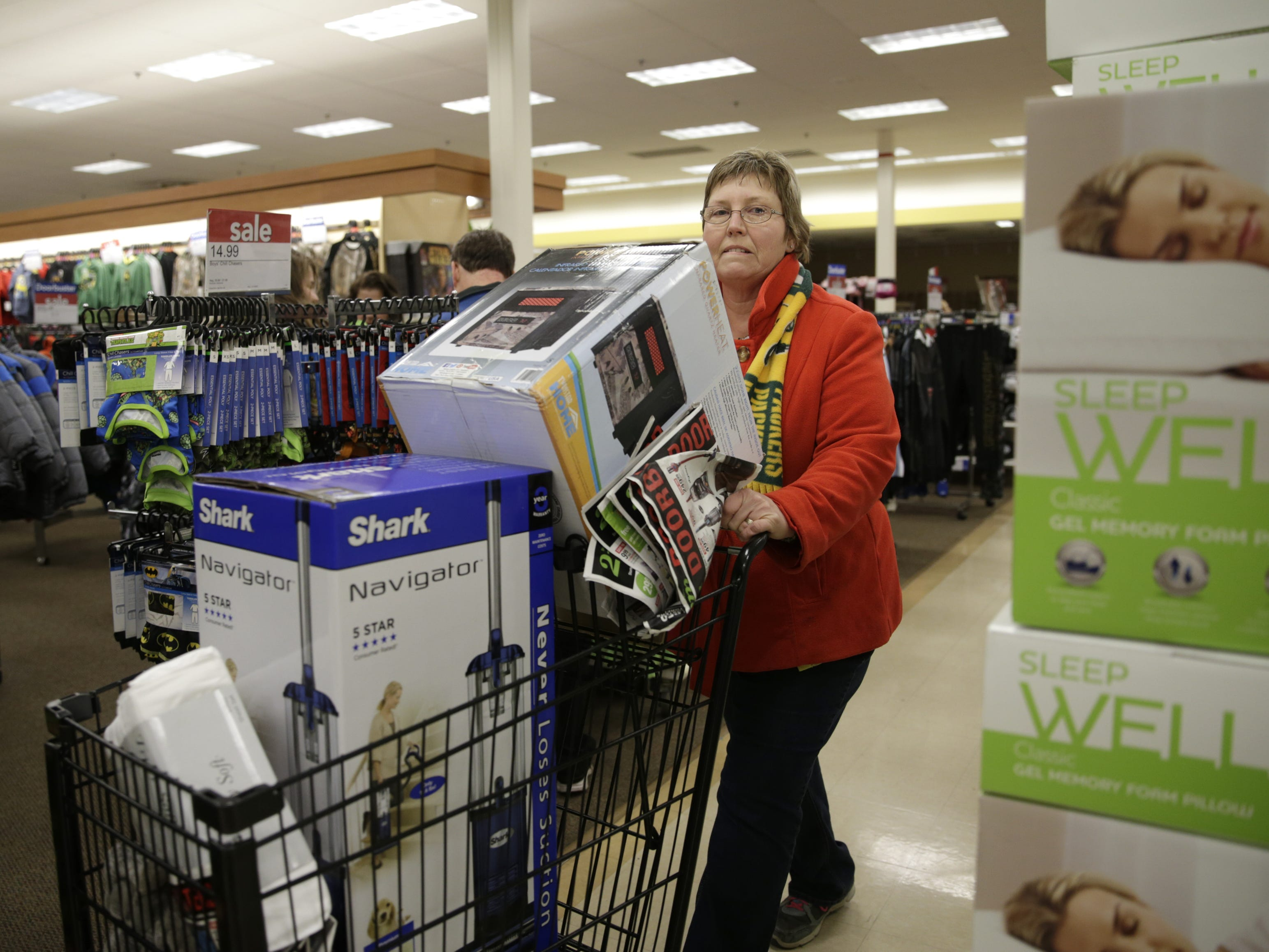 Robbin Zimmerman heads through the aisles at Shopko in Appleton during the store's Black Friday sale in 2015.