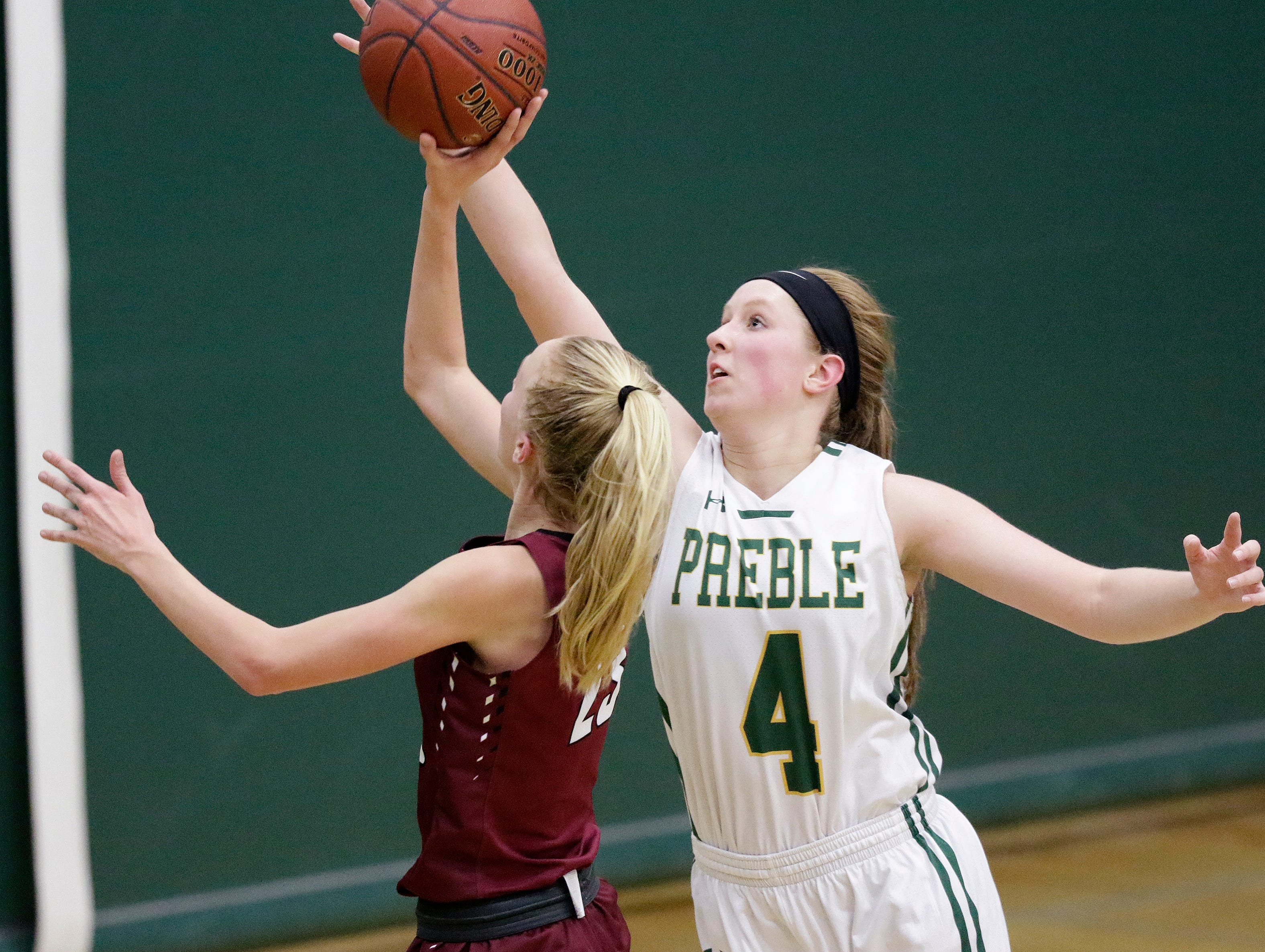 Green Bay Preble's Kendall Renard (4) guards De Pere's Jordan Meulemans (23) in a girls basketball game at Preble high school on Tuesday, January 8, 2019 in Green Bay, Wis.
