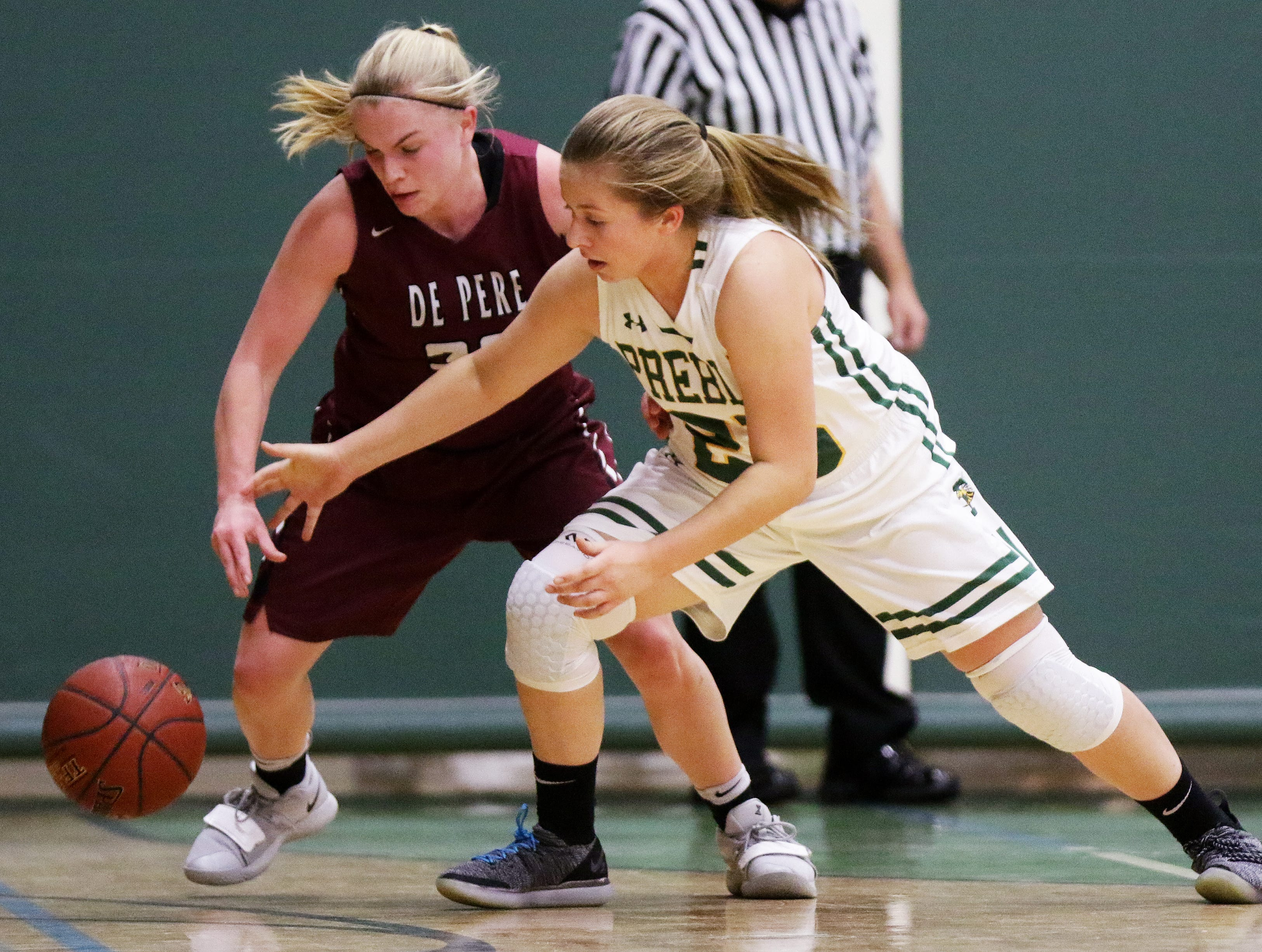 De Pere's Rachel Kerkhoff (30) steals the ball from Green Bay Preble's Carley Thiry (23) in a girls basketball game at Preble high school on Tuesday, January 8, 2019 in Green Bay, Wis.